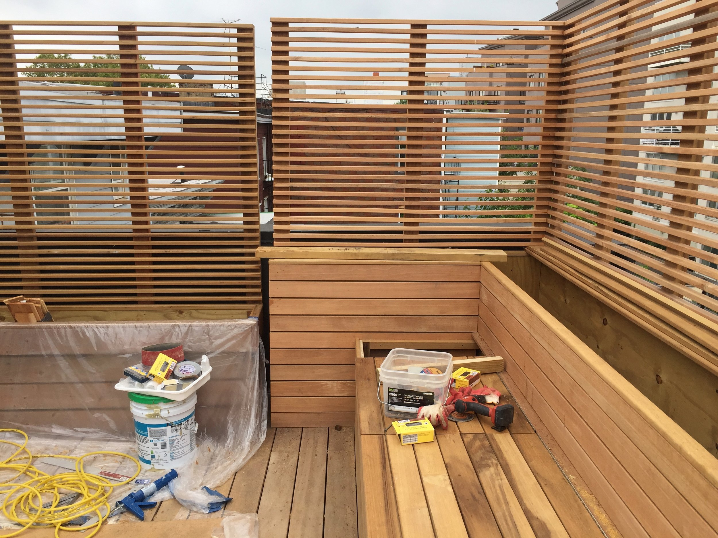 A New York residence gets a new custom deck as part of a full residential remodel