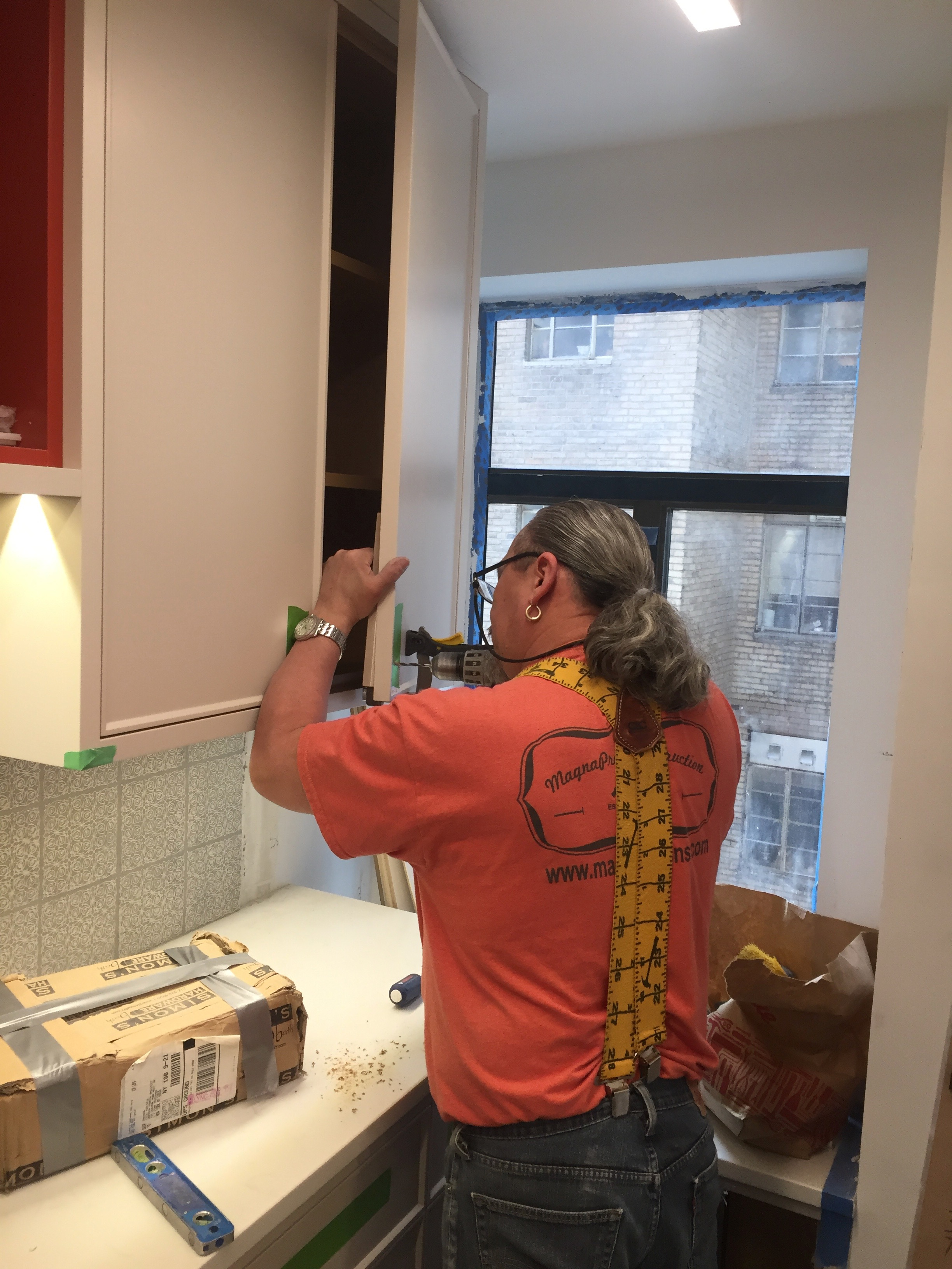 Our talented crew finishing a custom kitchen cabinet installation in New York City