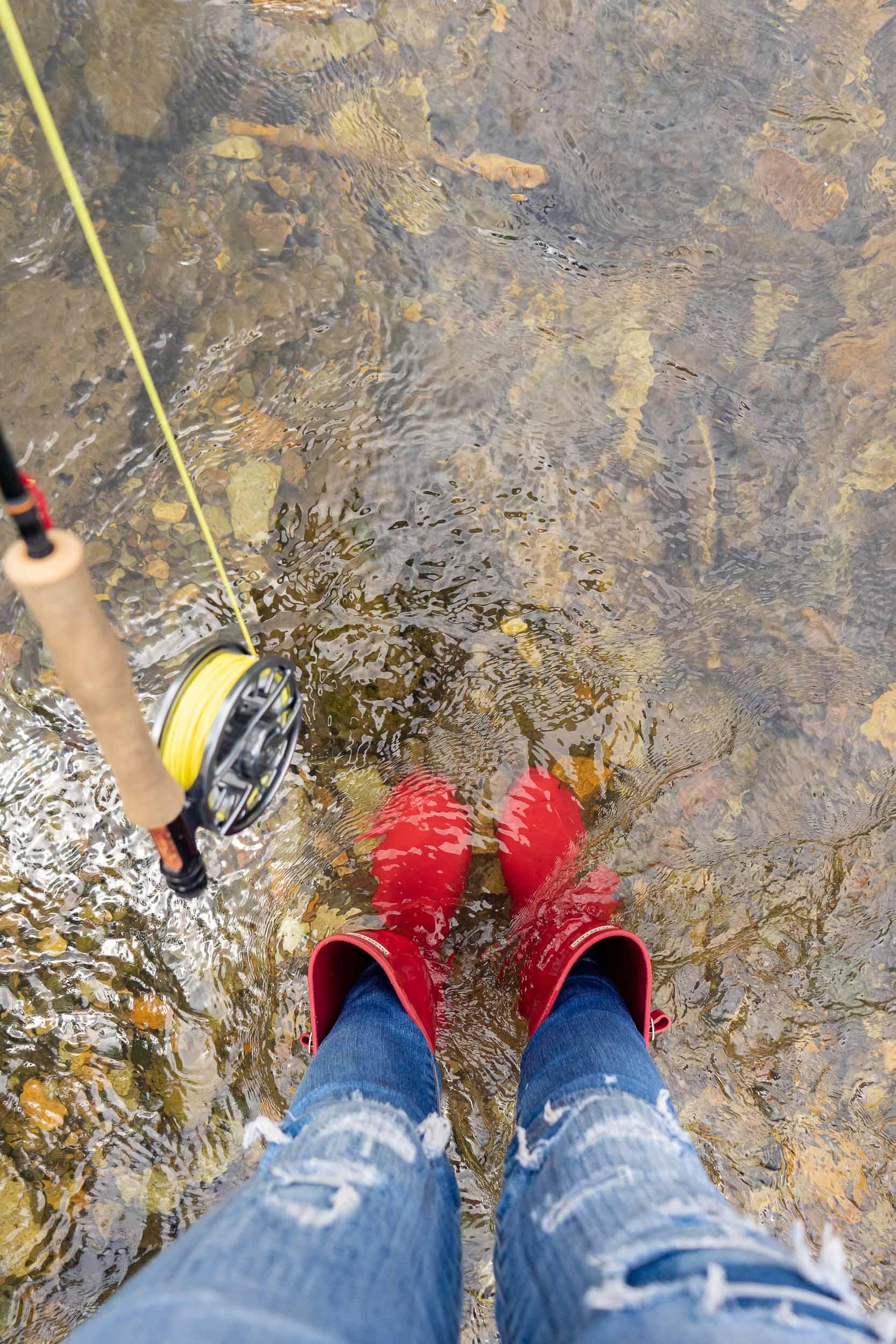 Fly fishing in Hunter rain boots near deer Creek Cabin forest service cabin near Big Timber, Montana