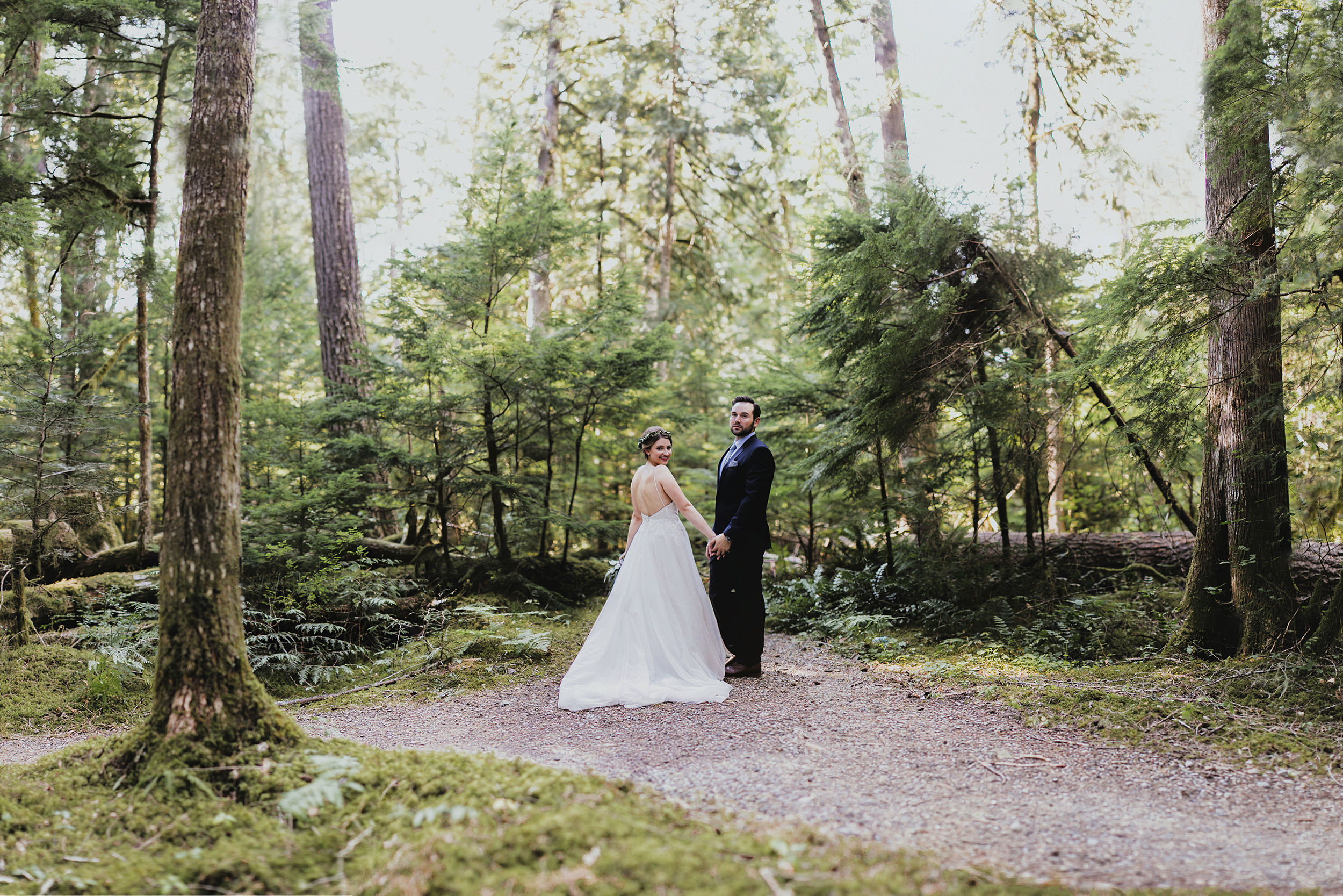 north cascades bride and groom first look in the forest