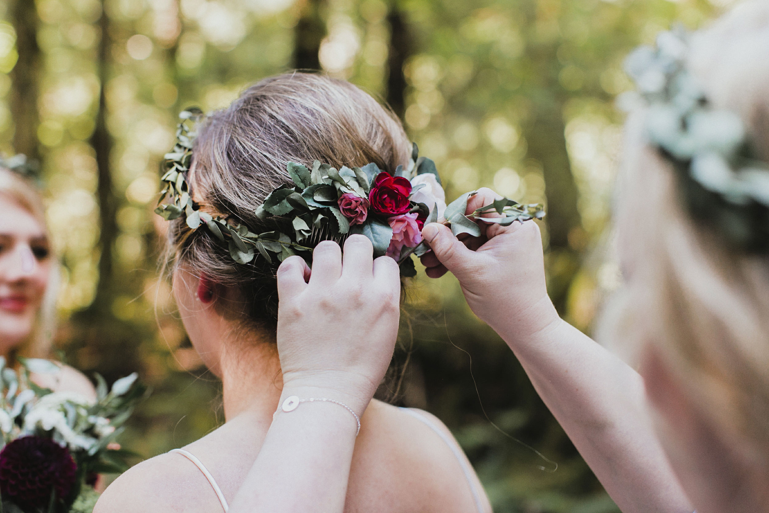 bride's floral crown being put on in the Newhalem campground