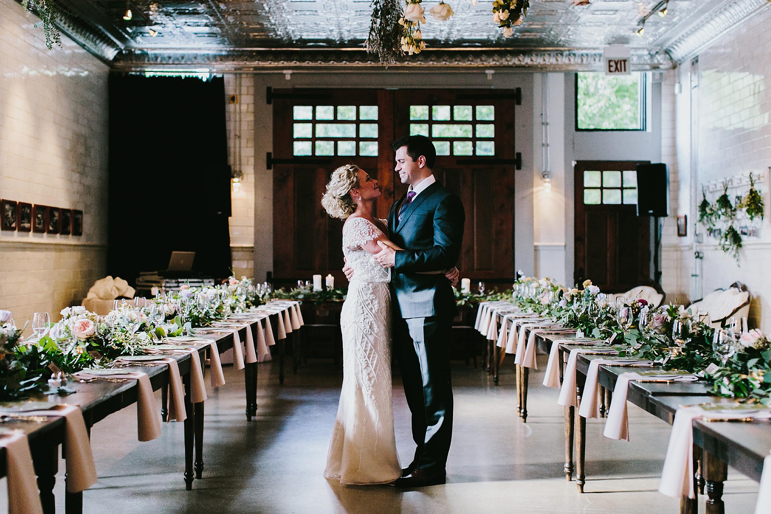 bride and groom in Asrai Garden wedding arrangements in Firehouse Chicago, Illinois