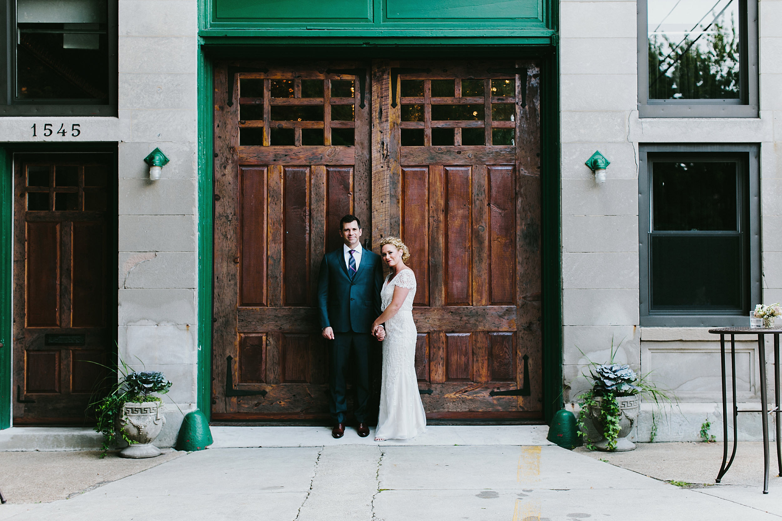 bride and groom in front of fire engine doors at Firehouse Chicago, Illinois