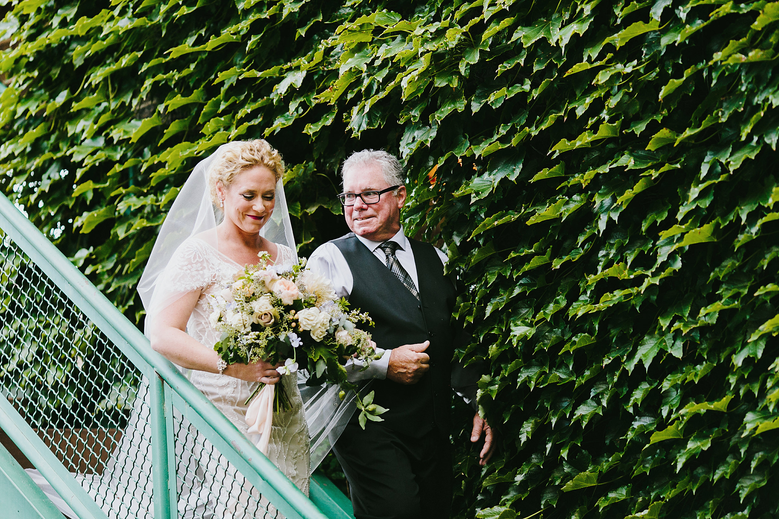 father of the bride and the bride processional to the ceremony at firehouse Chicago, Illinois