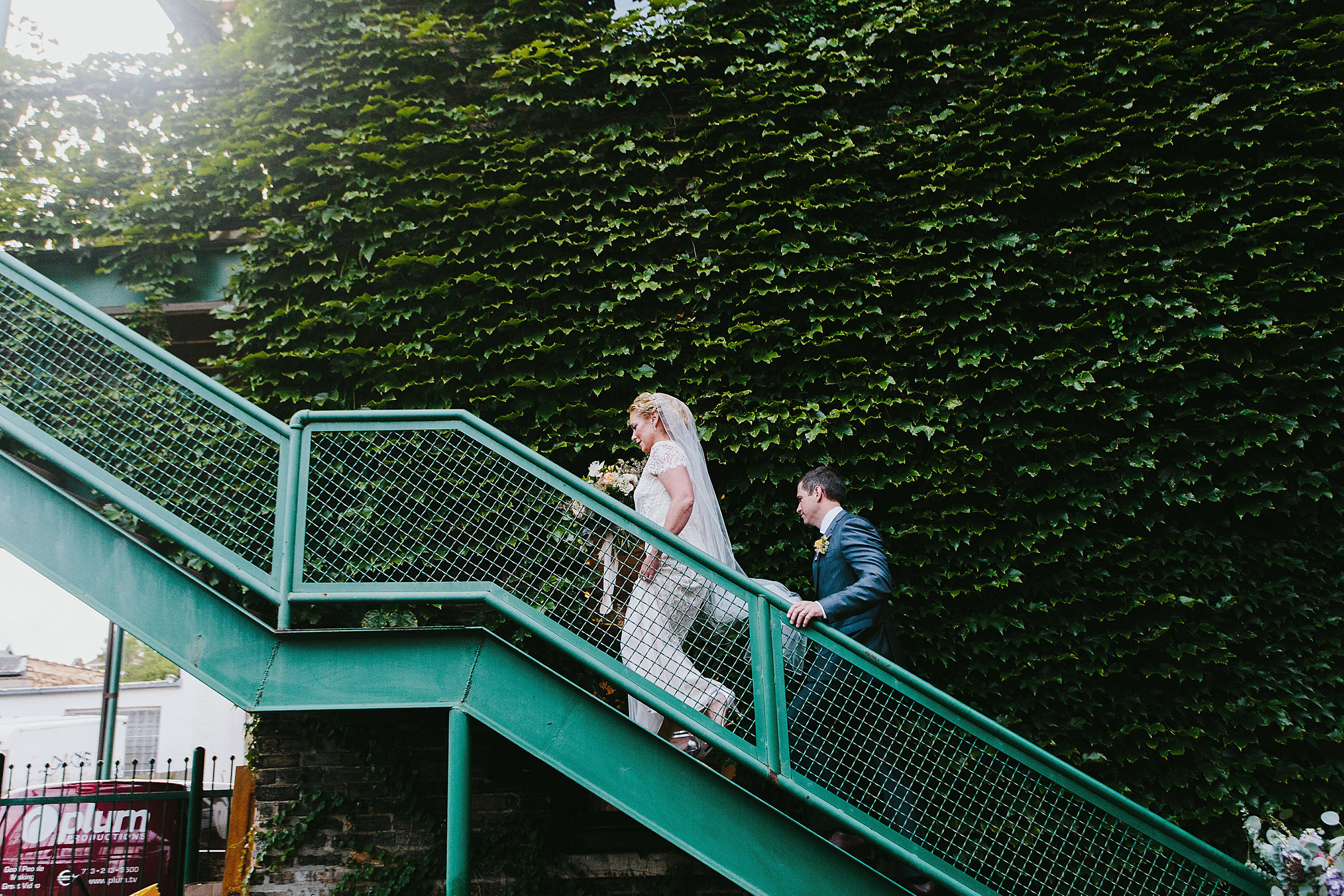 Ceremony recessional bride and groom exit through stairs at firehouse Chicago
