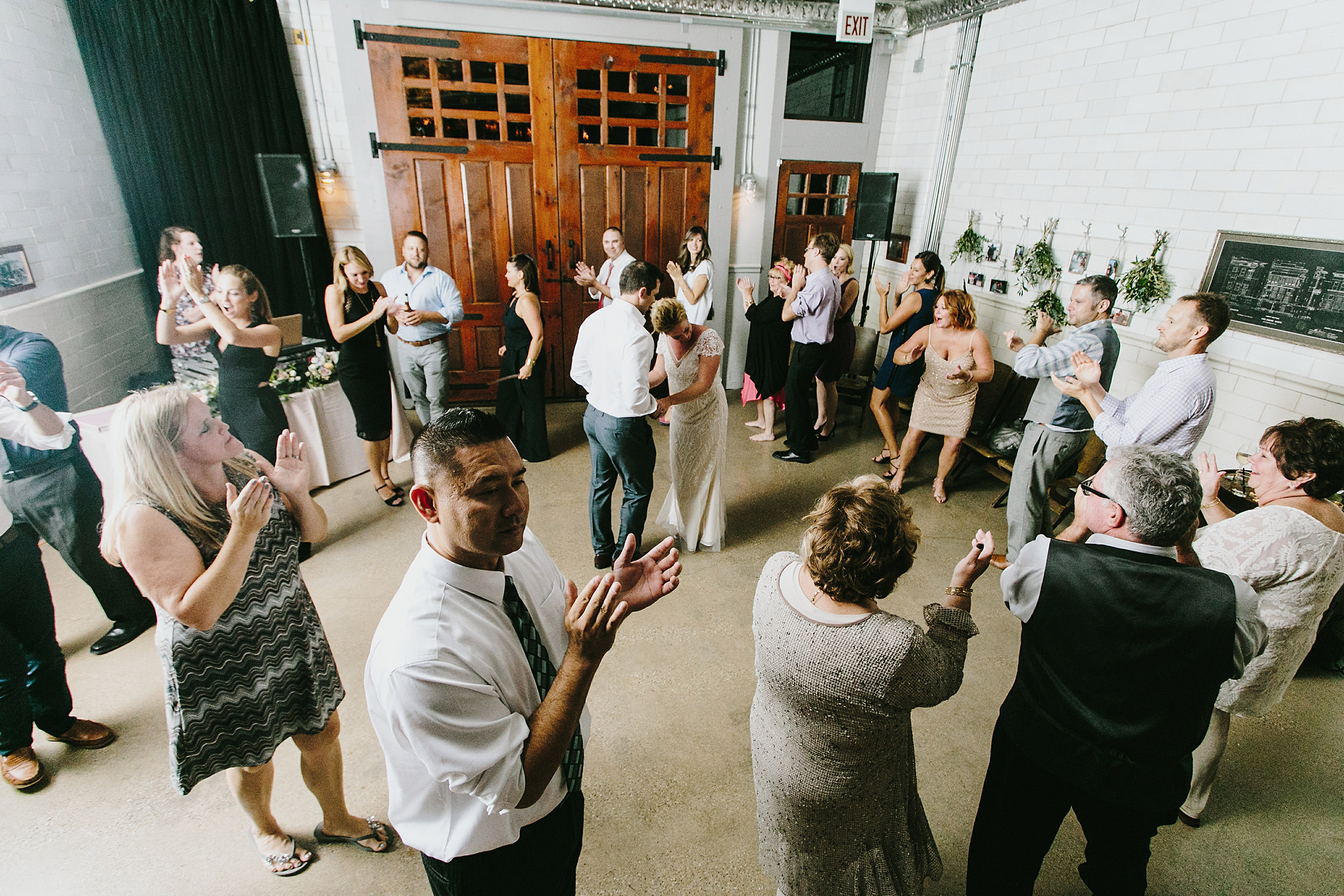 Circle dance around the bride at groom at Firehouse Chicago