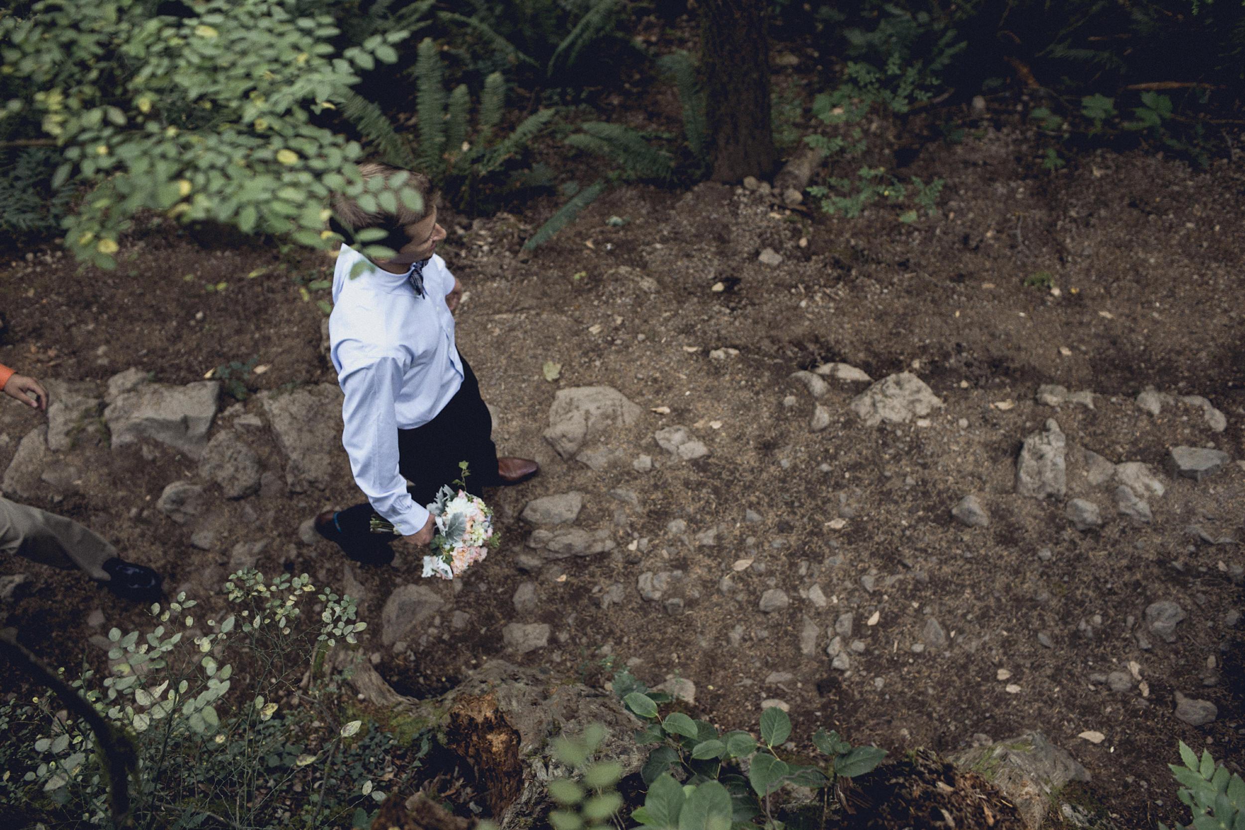 groom hiking rattlesnake ridge trail for an elopement