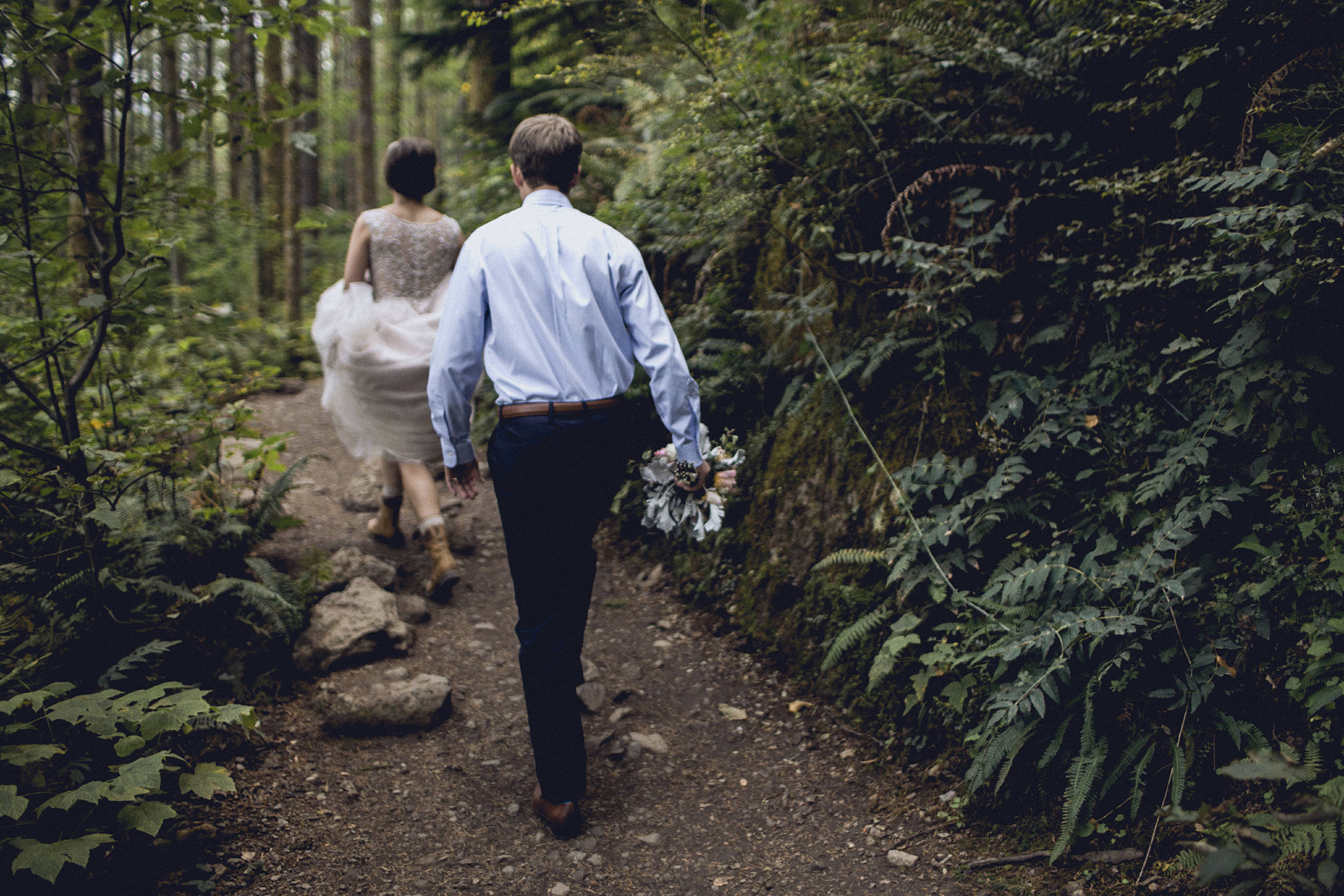 bride and groom hiking rattlesnake ridge trail for an elopement