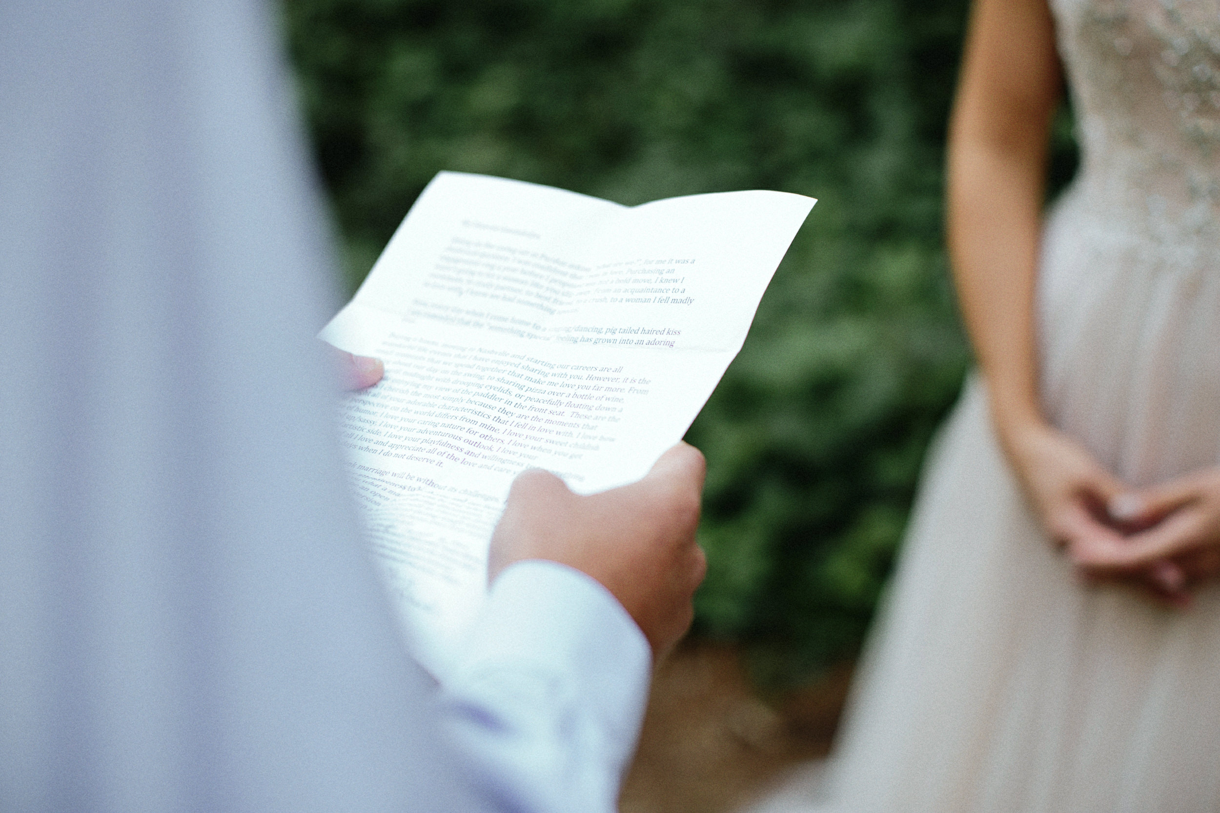 groom reading vows during an elopement in a forest cathedral on rattlesnake ridge