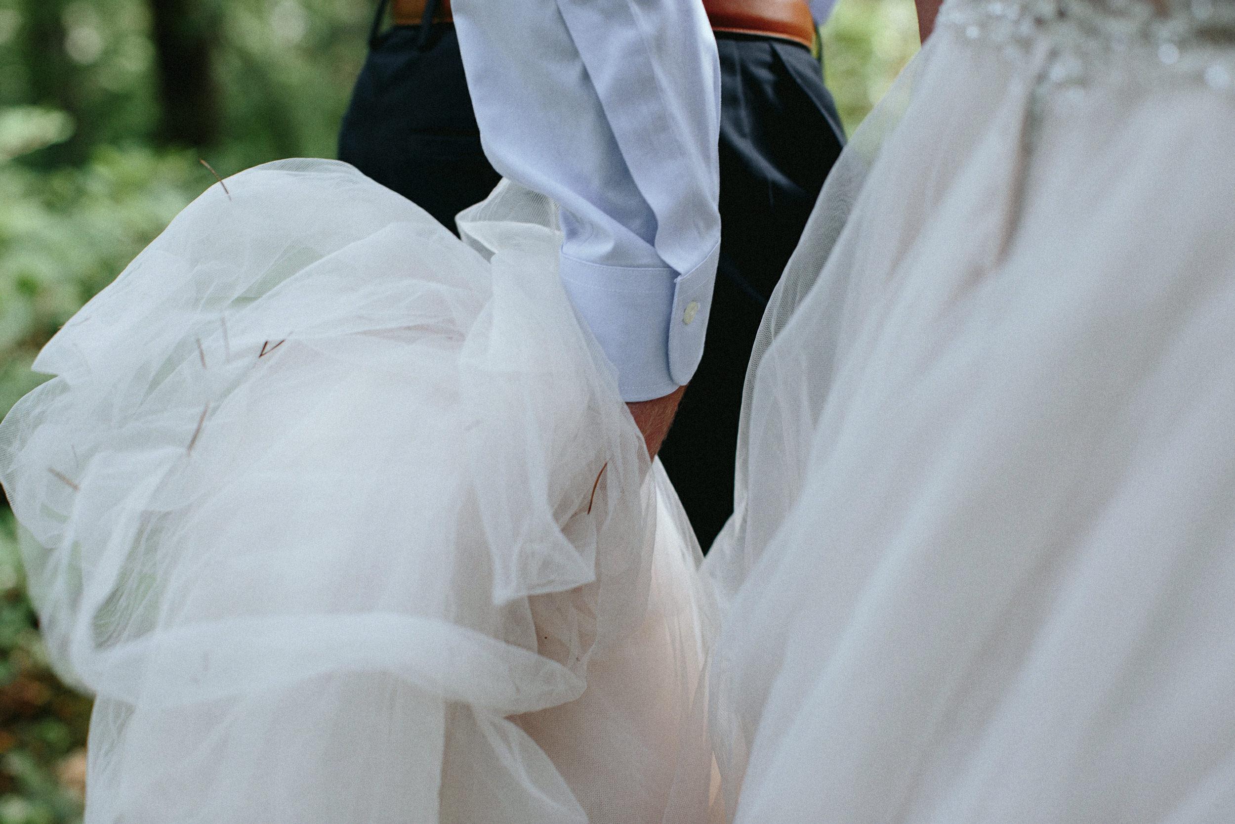 groom carries bride's dress while hiking rattlesnake ridge