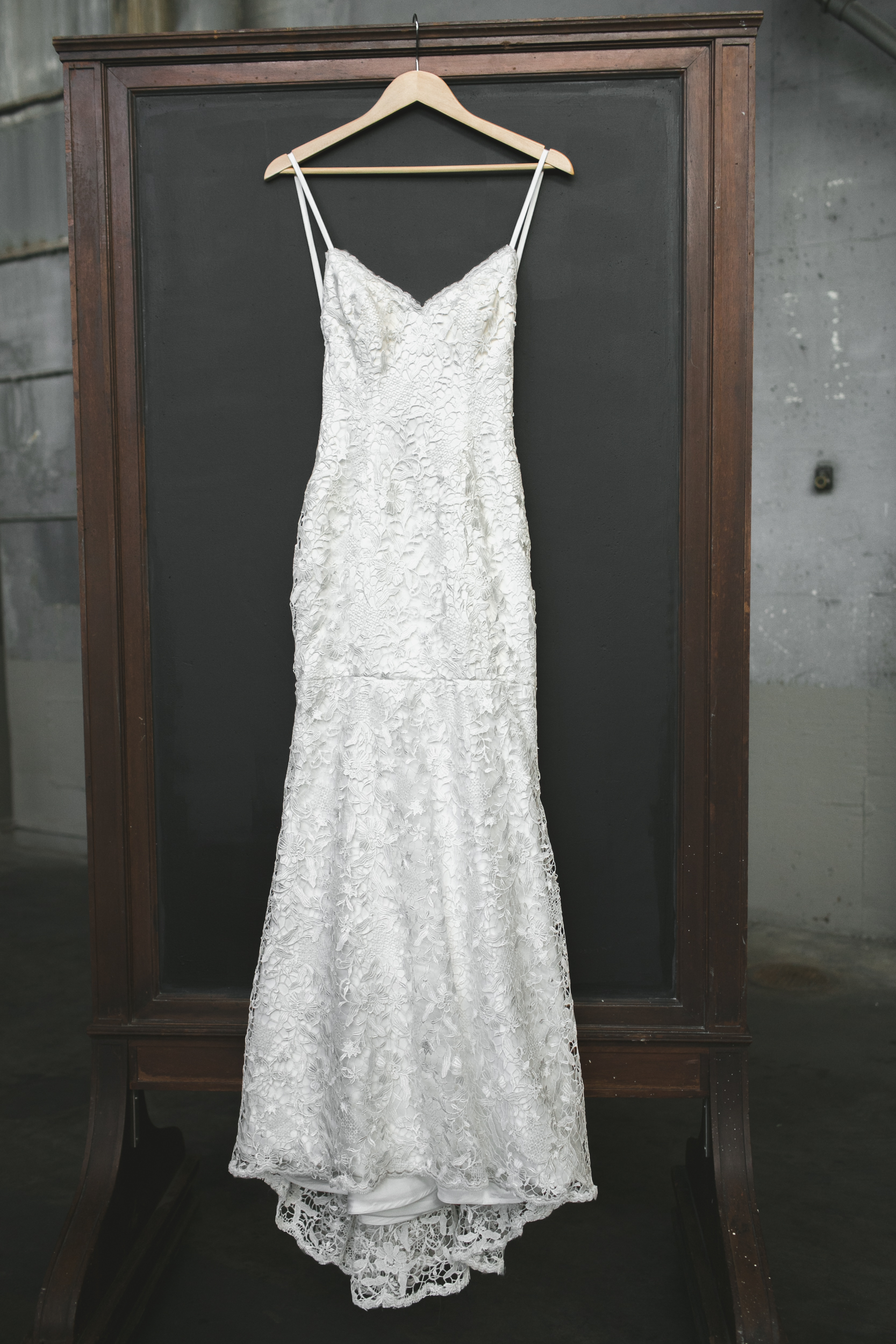 full length photograph of the brides dress hanging