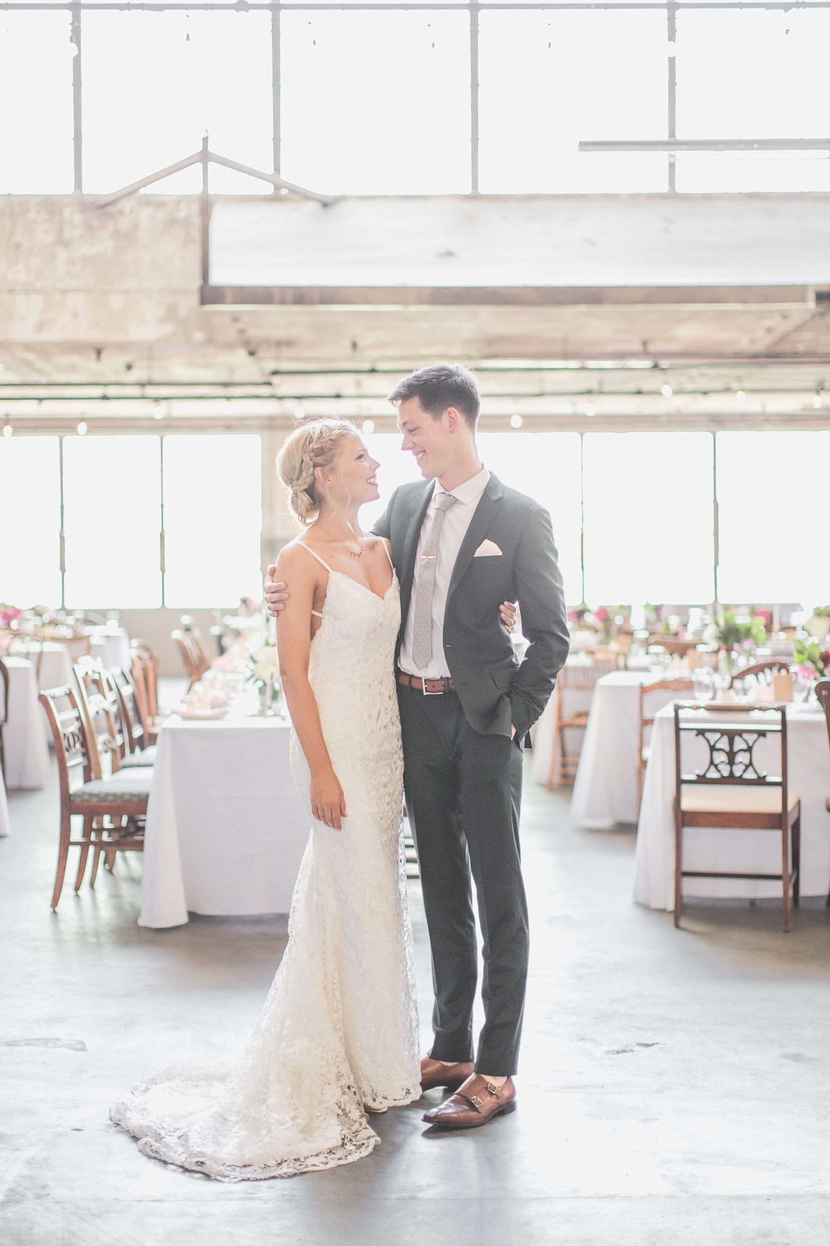 bride and groom standing in the Hotel max artist loft