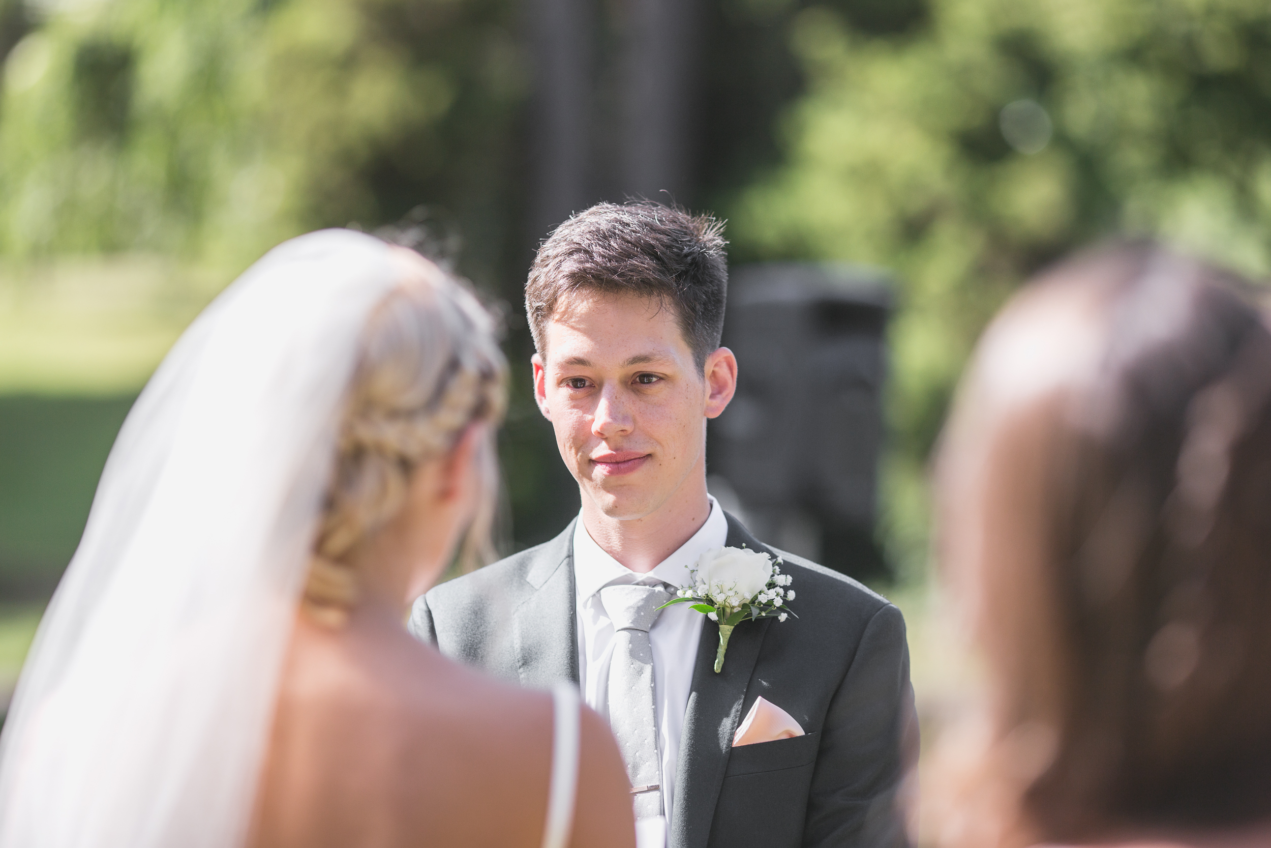 groom faces bride at the alter at leschi park in seattle