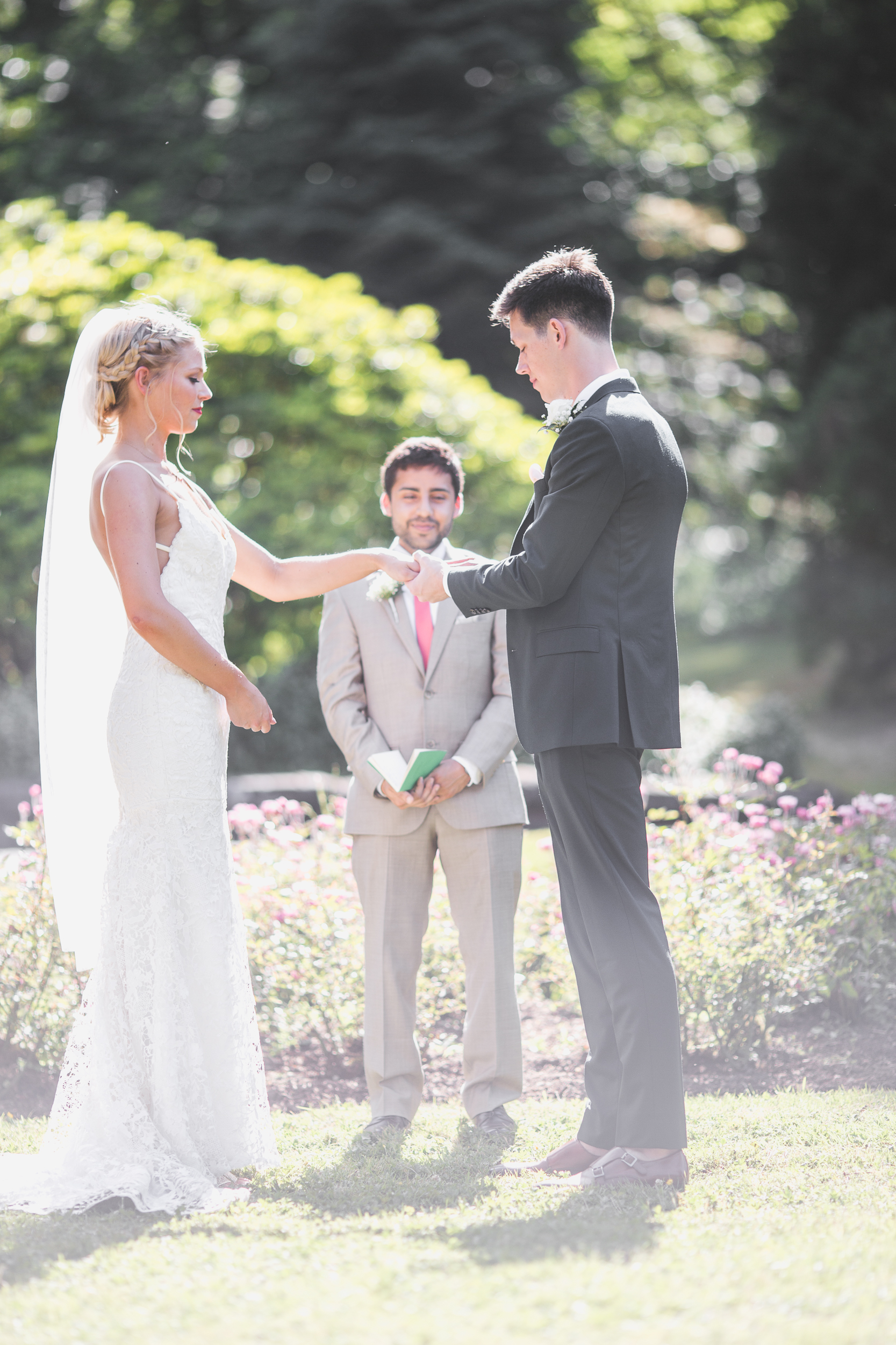 exchanging rings at the alter in leschi park in seattle for a wedding