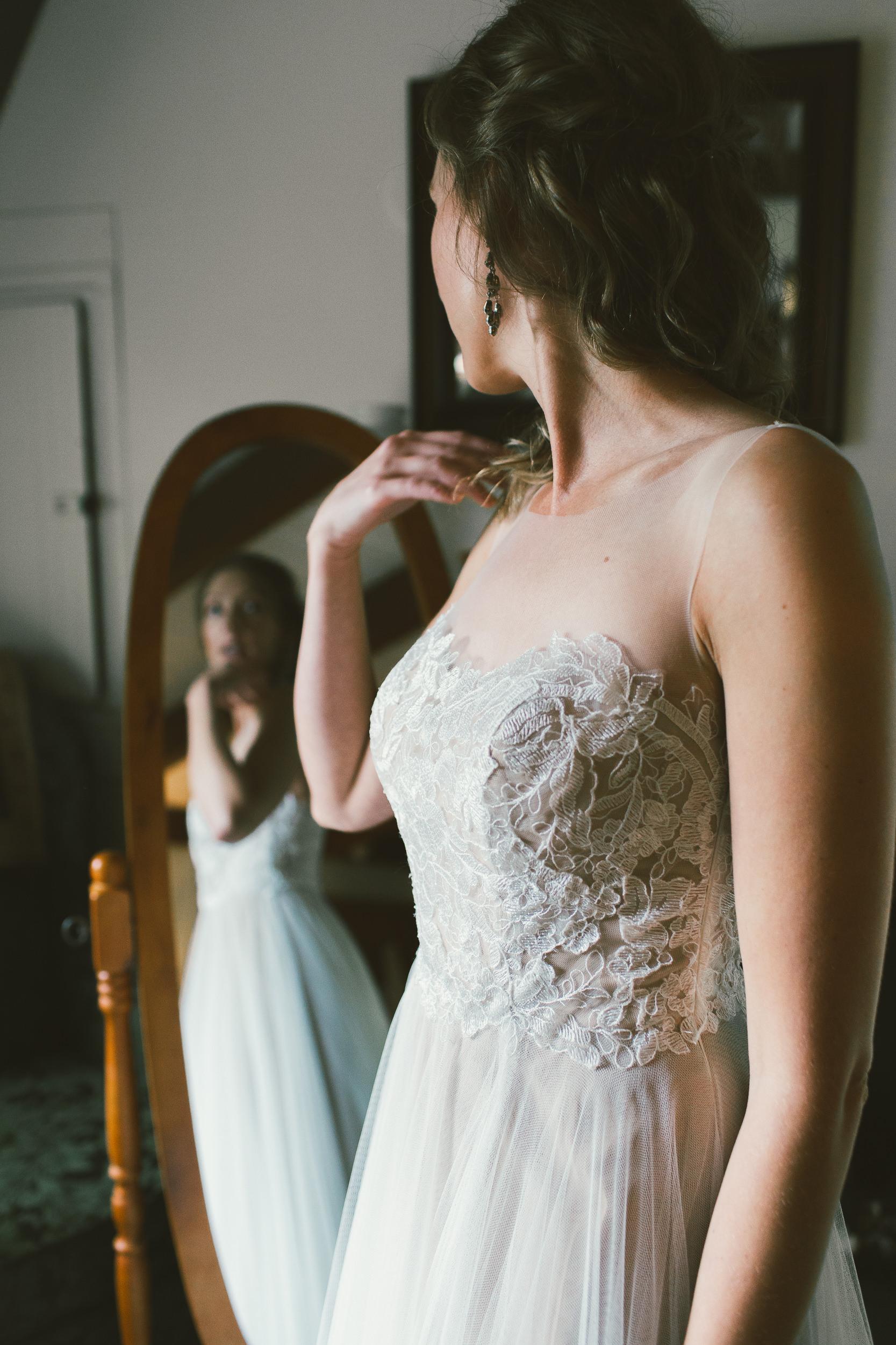 bride admiring herself in the mirror