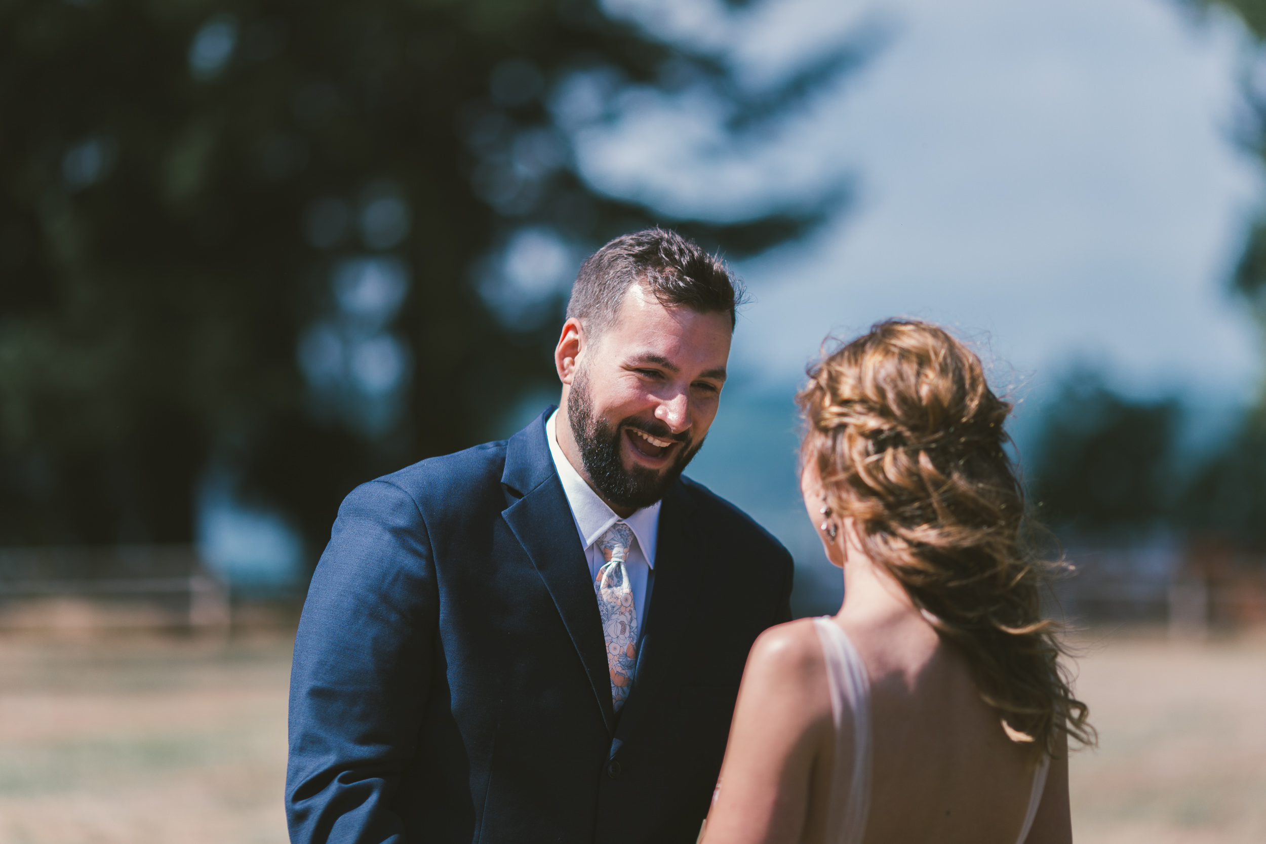 groom's face reaction to the first look