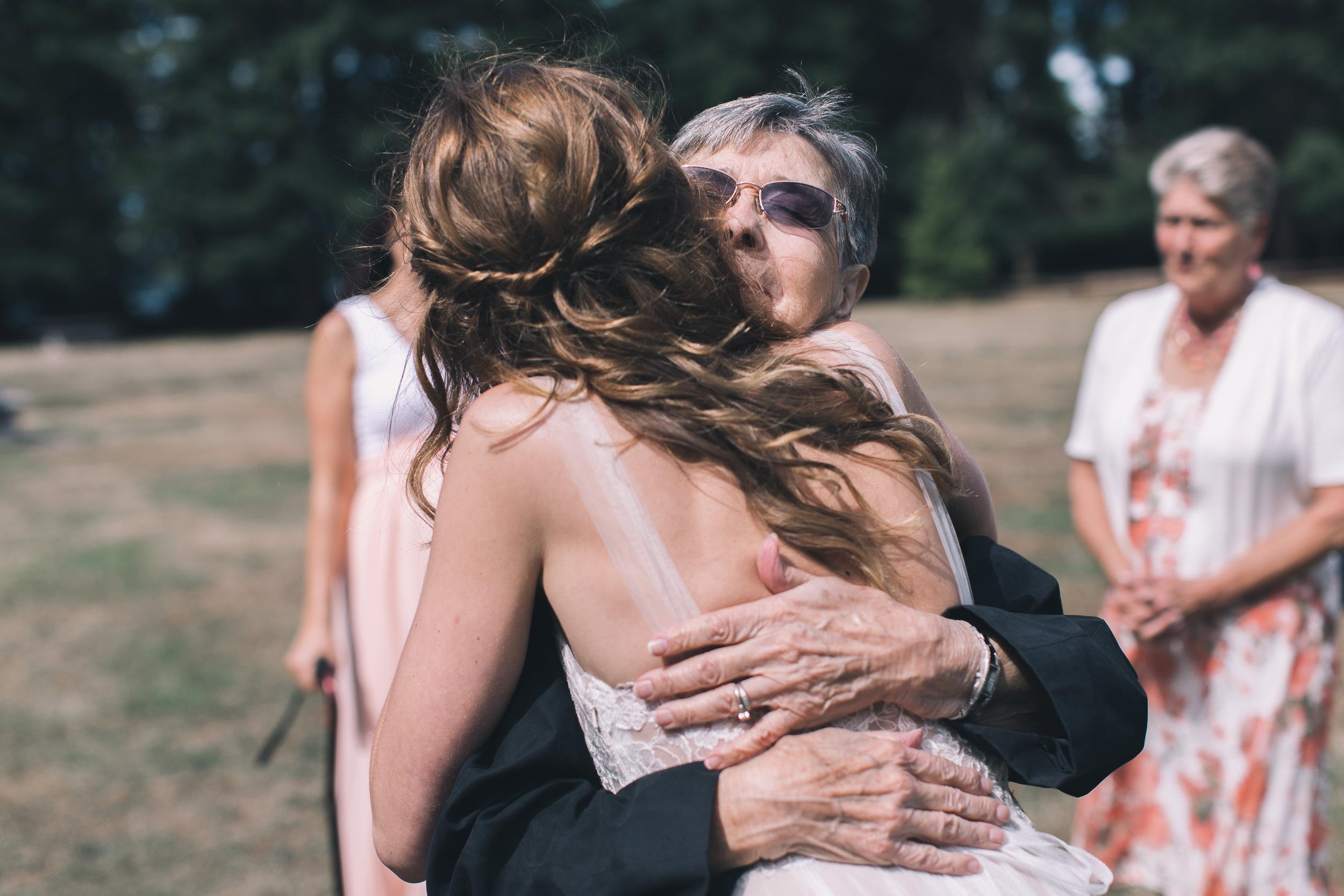 bride hugging grandma at kitsap memorial state park