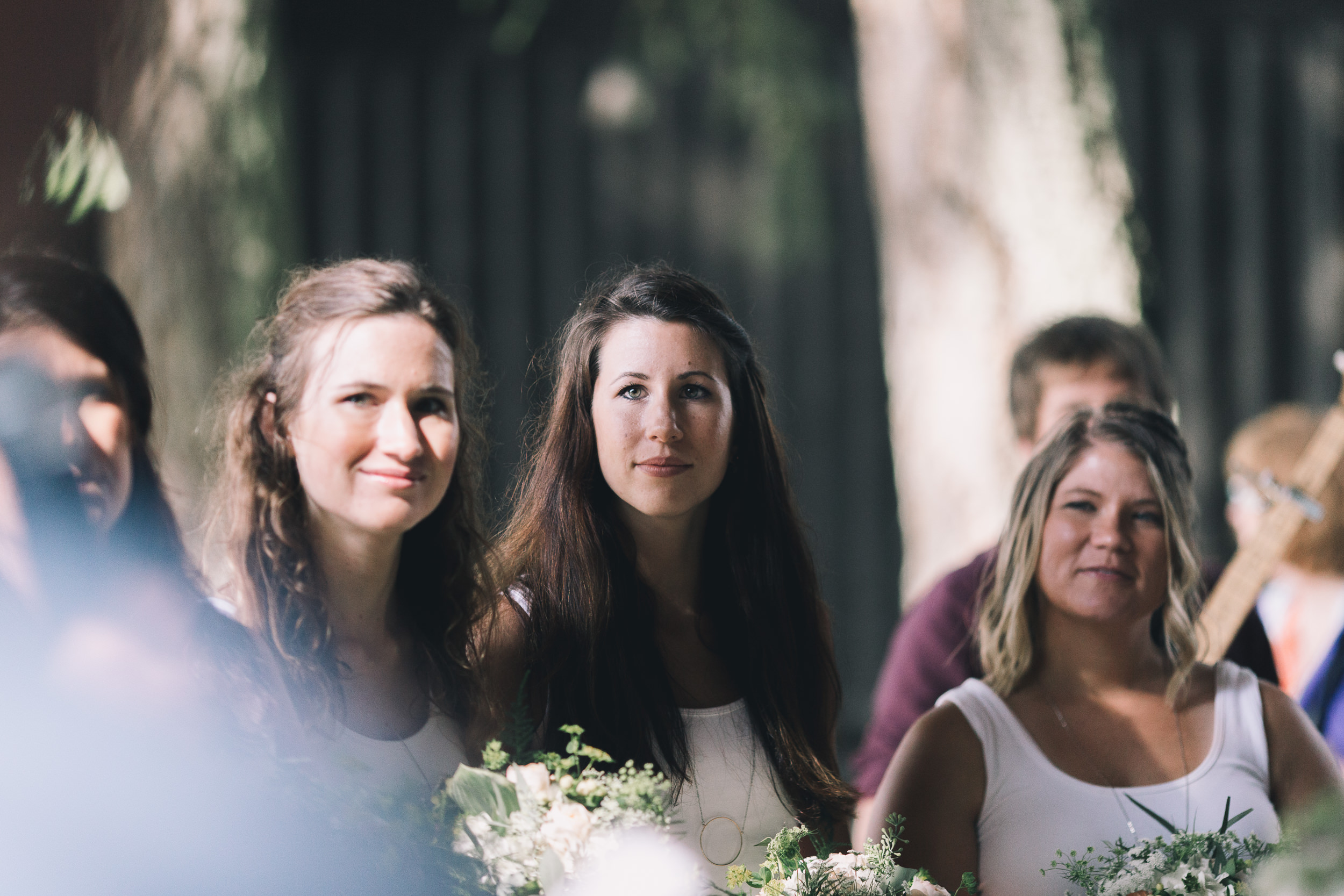 kitsap memorial state park  bridesmaids look at bride