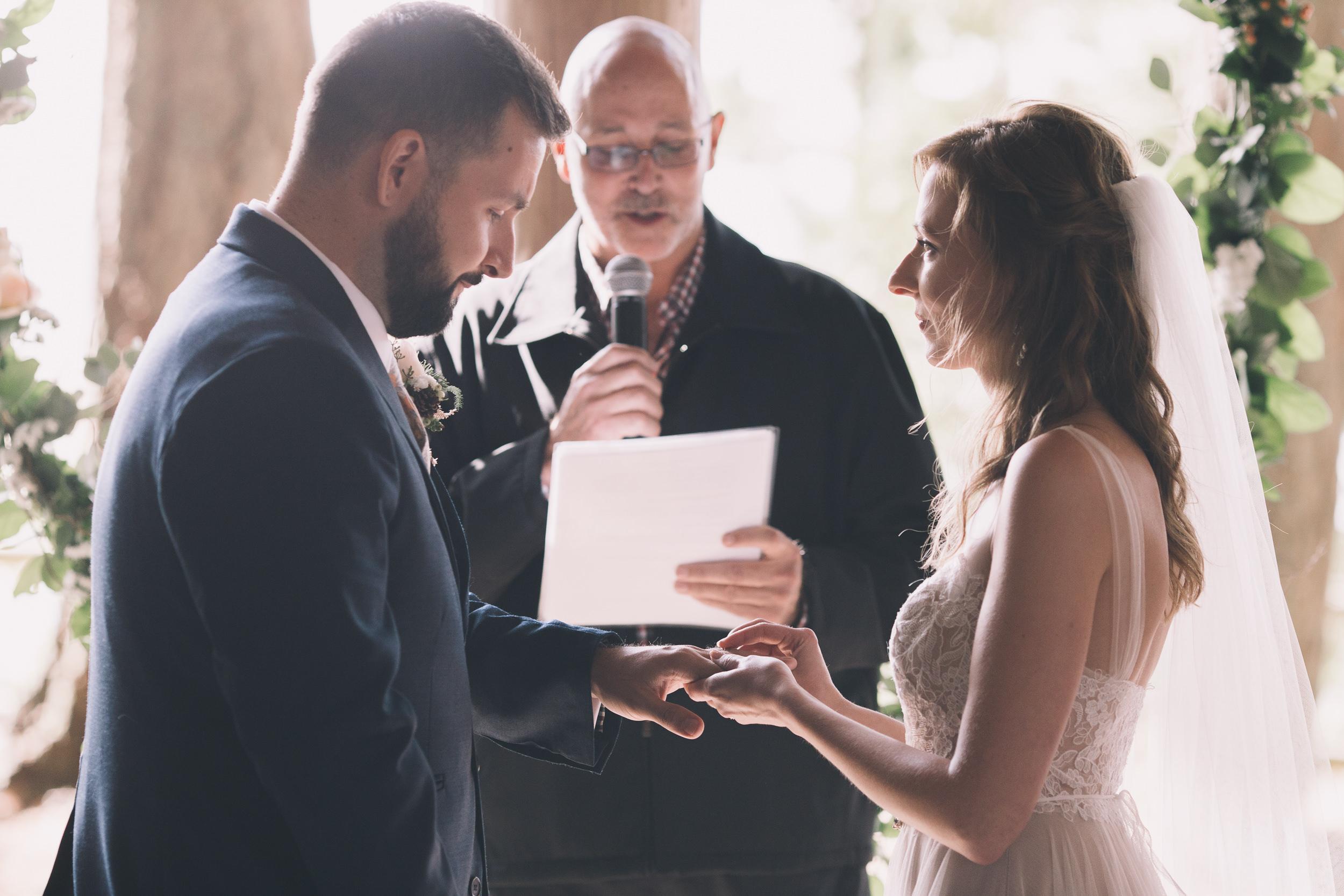 kitsap memorial state park exchanging rings at wedding