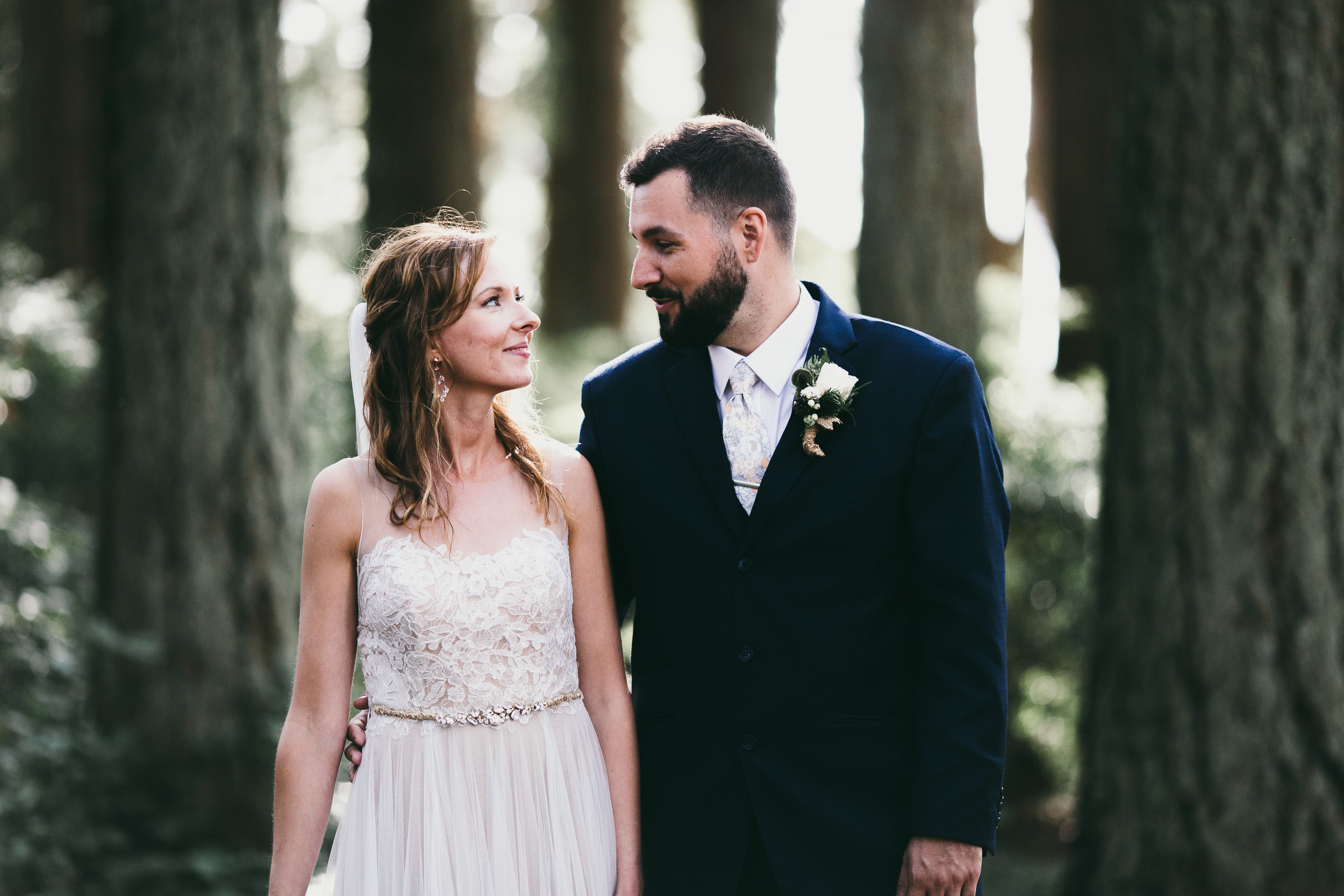 kitsap memorial state park bride and groom look lovingly into each other's eyes