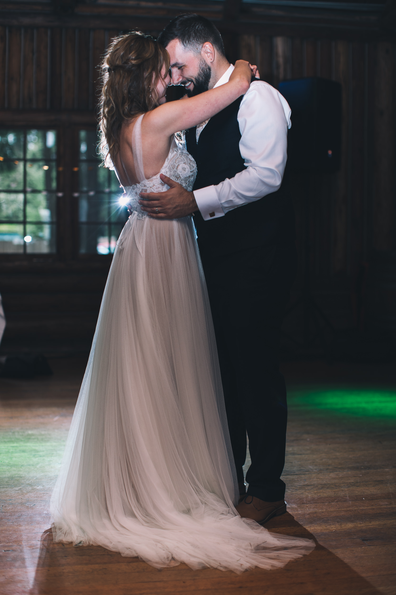 bride and groom dance at kitsap memorial state park log hall