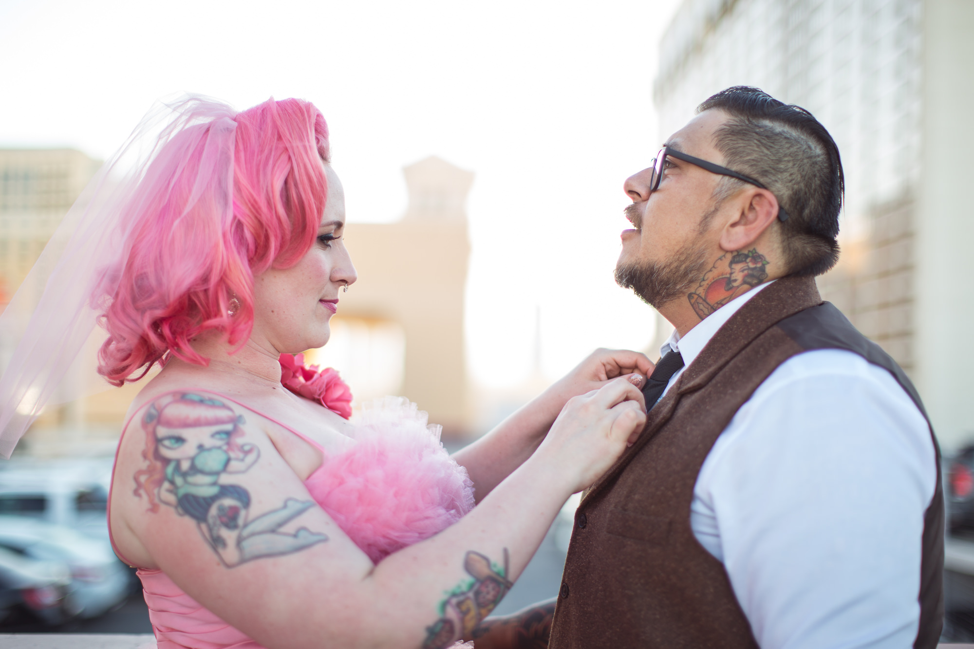 pink tattooed bride and groom
