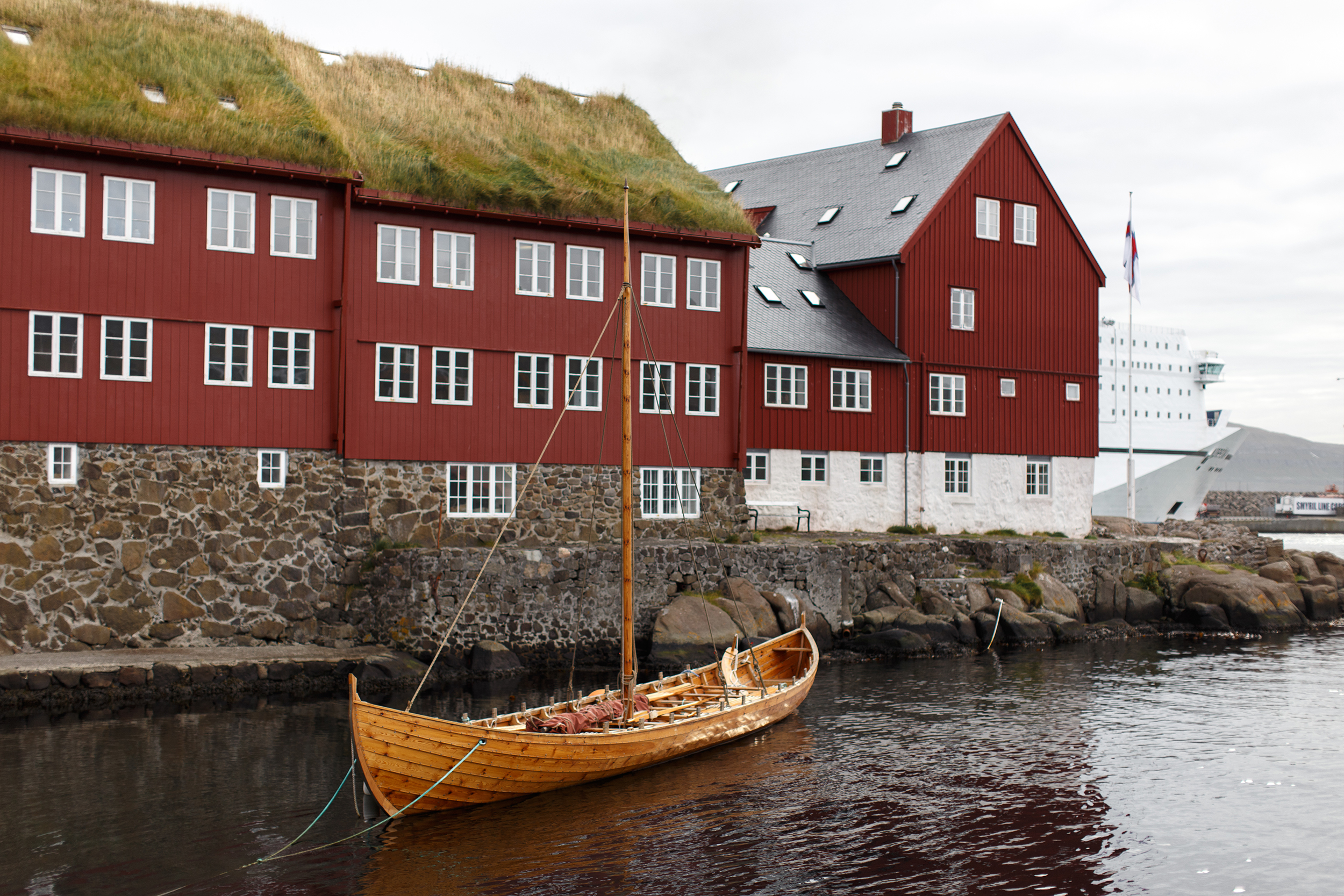 Tórshavn government buildings and longboat