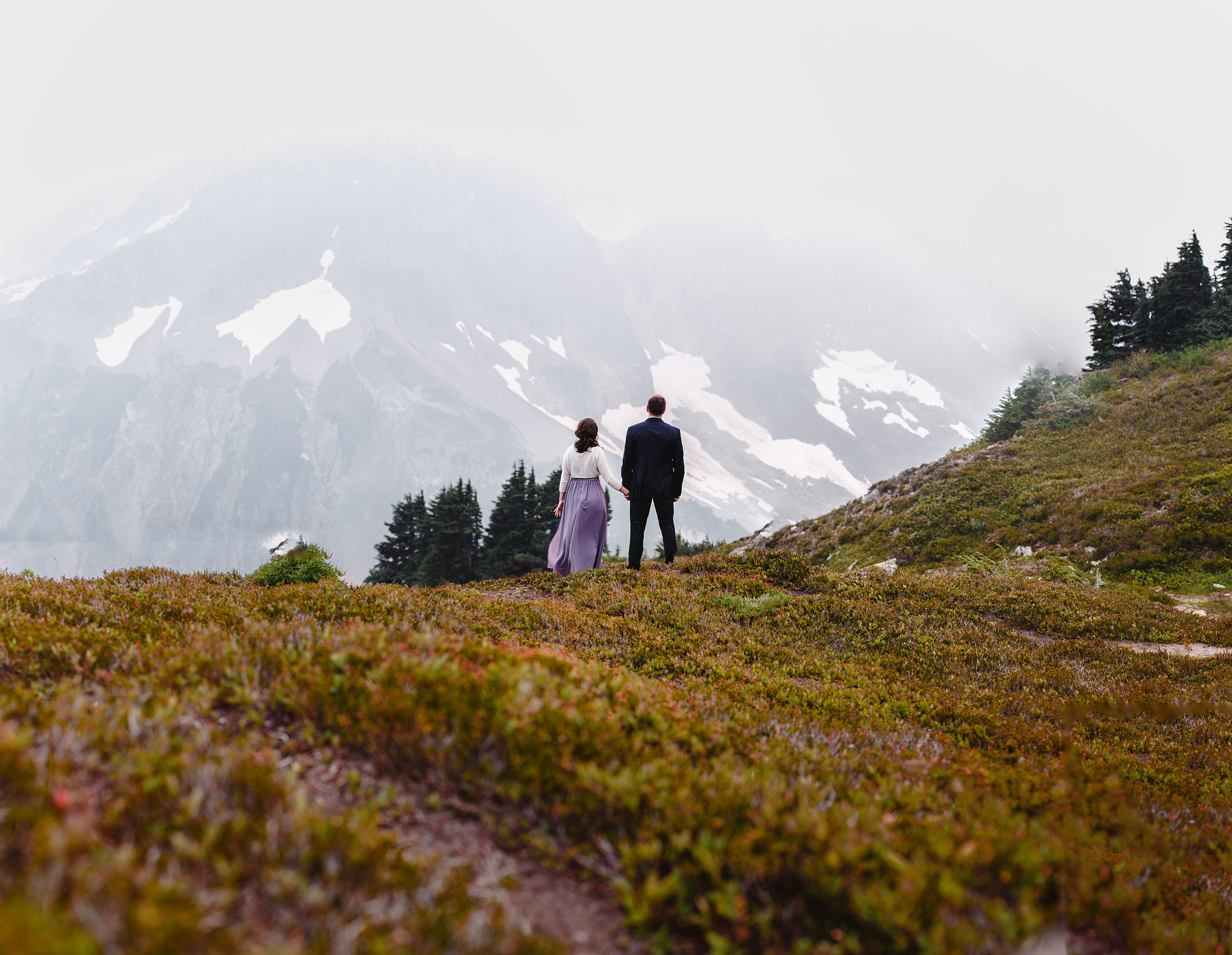 north cascades hiking photoshoot for an engaged couple. looking out from cascade pass