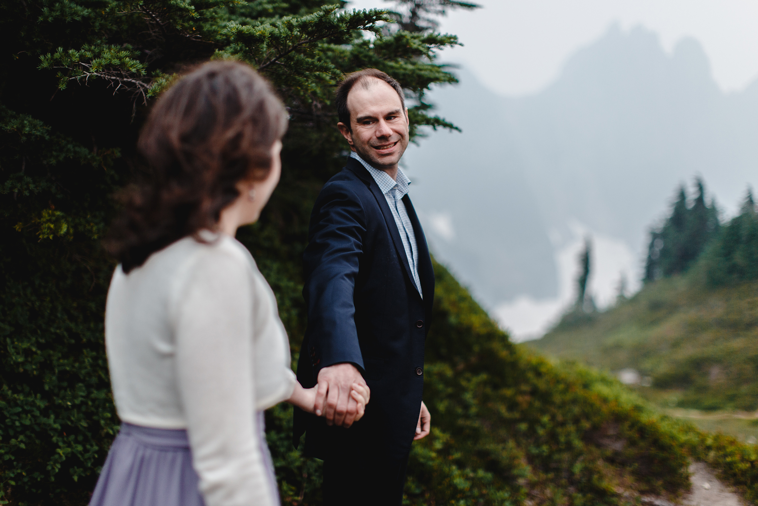 """""""come with me"""" engagement photo in the cascade mountains"""