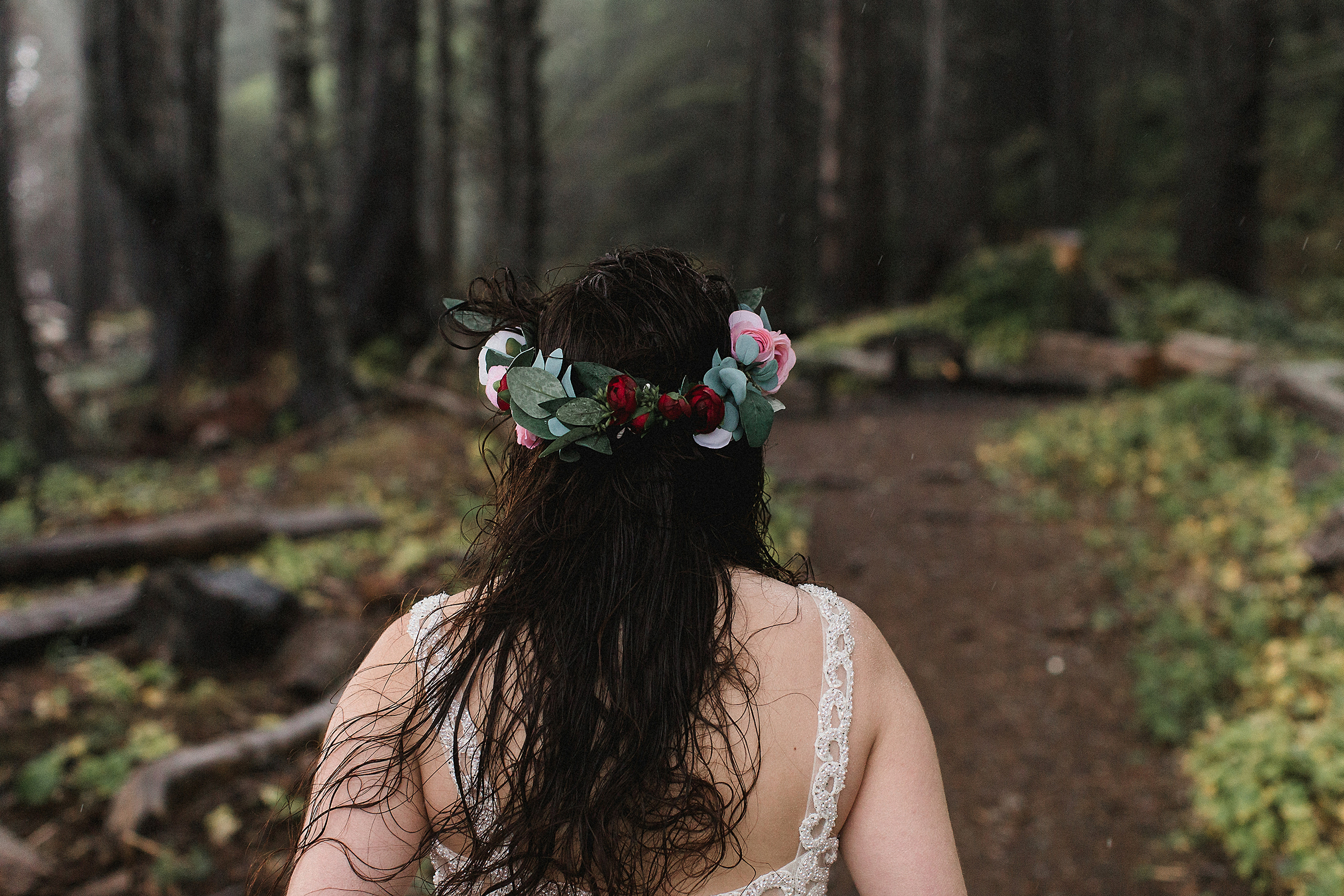 Bride on a windy and rainy day in the Olympic National Park