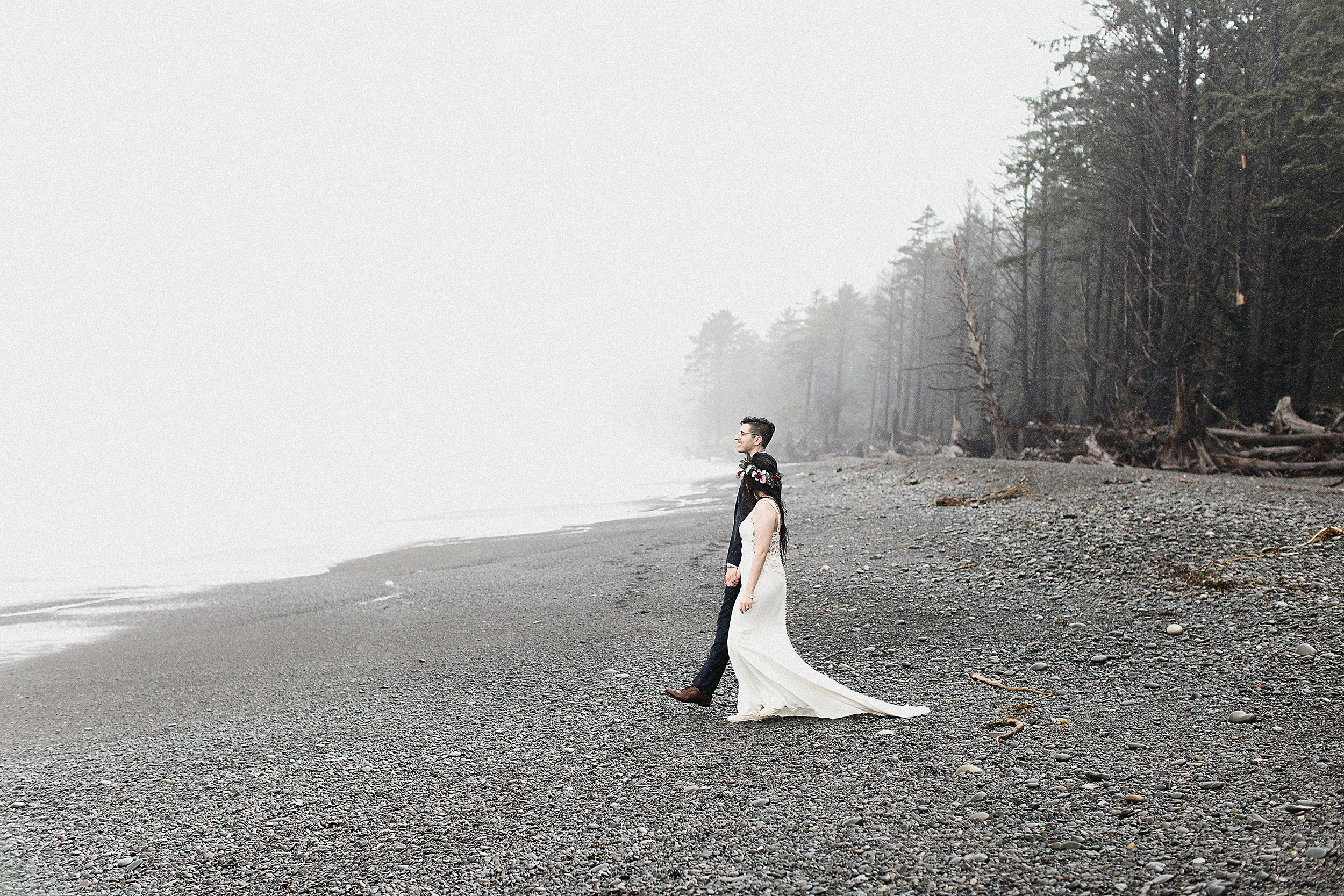 bride and groom walking on the beach at the Olympic National Park