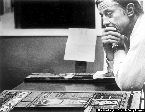 "Ben Bradlee in the Post's composing room with the front page of the first edition, headlined ""Nixon Resigns."" on Aug. 8, 1974. Photo by David R. Legge/The Washington Post via Getty images"