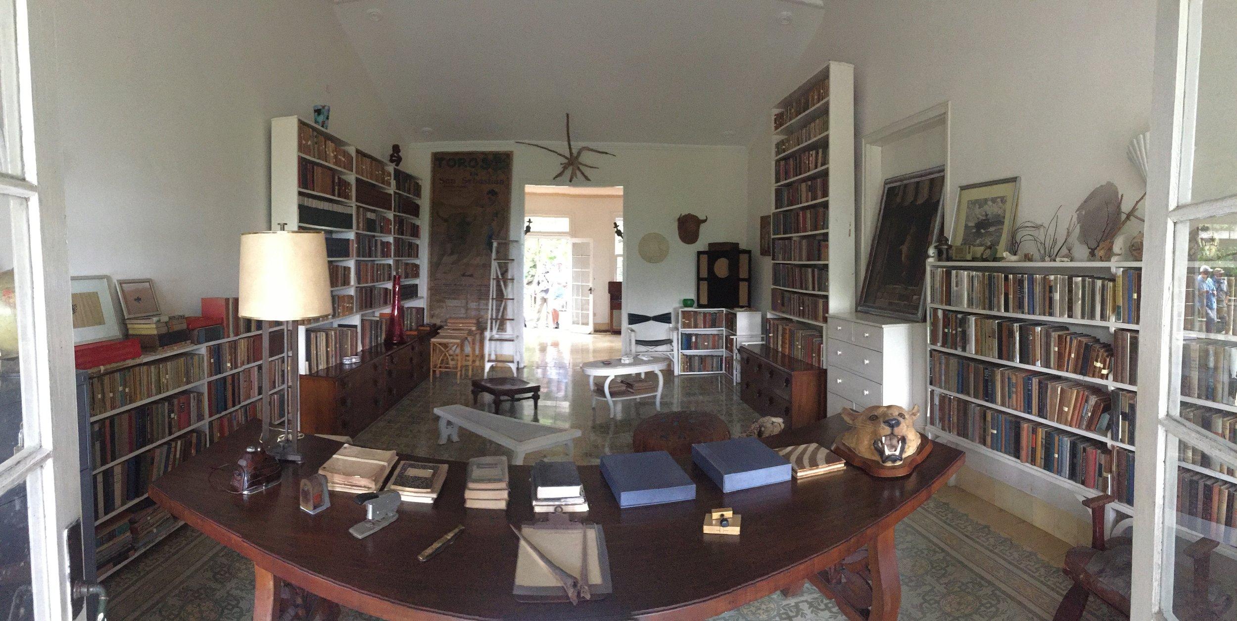 The interior of Finca Vigía, Hemingway's home outside Havana. Many books, many guns, many big game trophies.