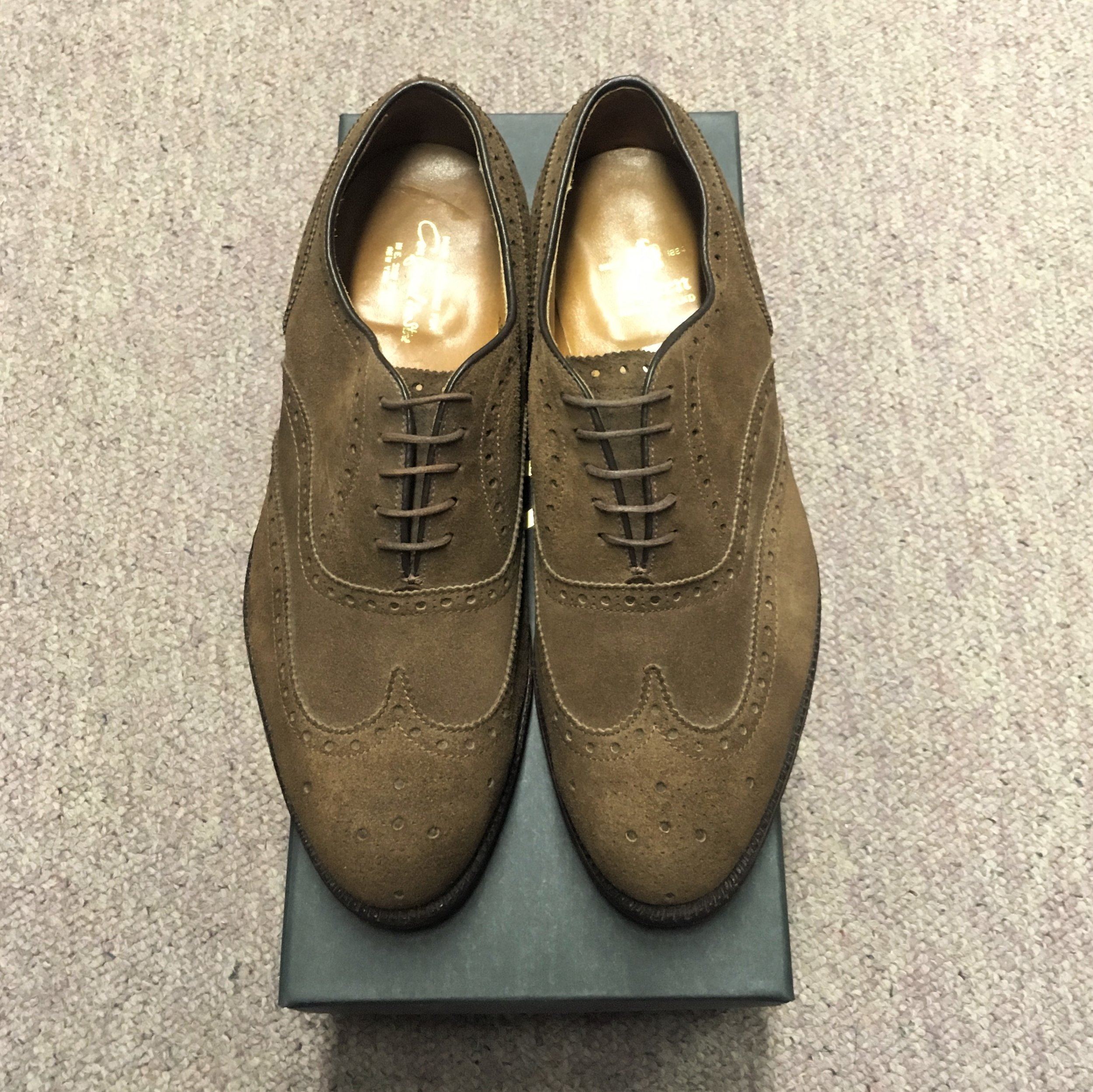 #904 - Hampton LastBrown Suede - Wing Tip Balmoral - Leather SoleDiscontinued ModelLAST PAIRS SIZES 8EEE & 10EEEMSRP $569Contact us for Pricing and Availability
