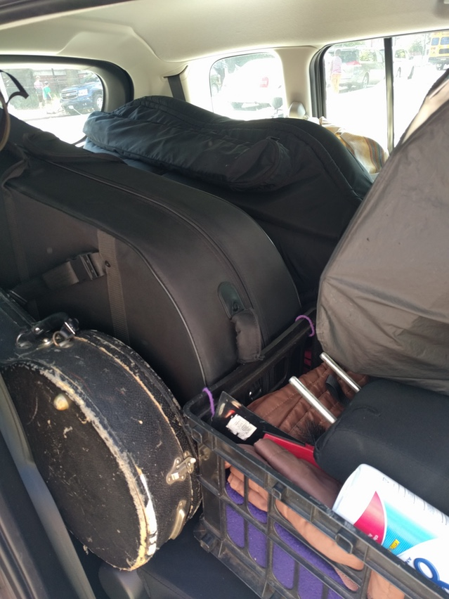 Packing up the kids (Left to Right: Banjo, Tuba, Bass. Not pictured: Saxophone, Clarinet, Flute)