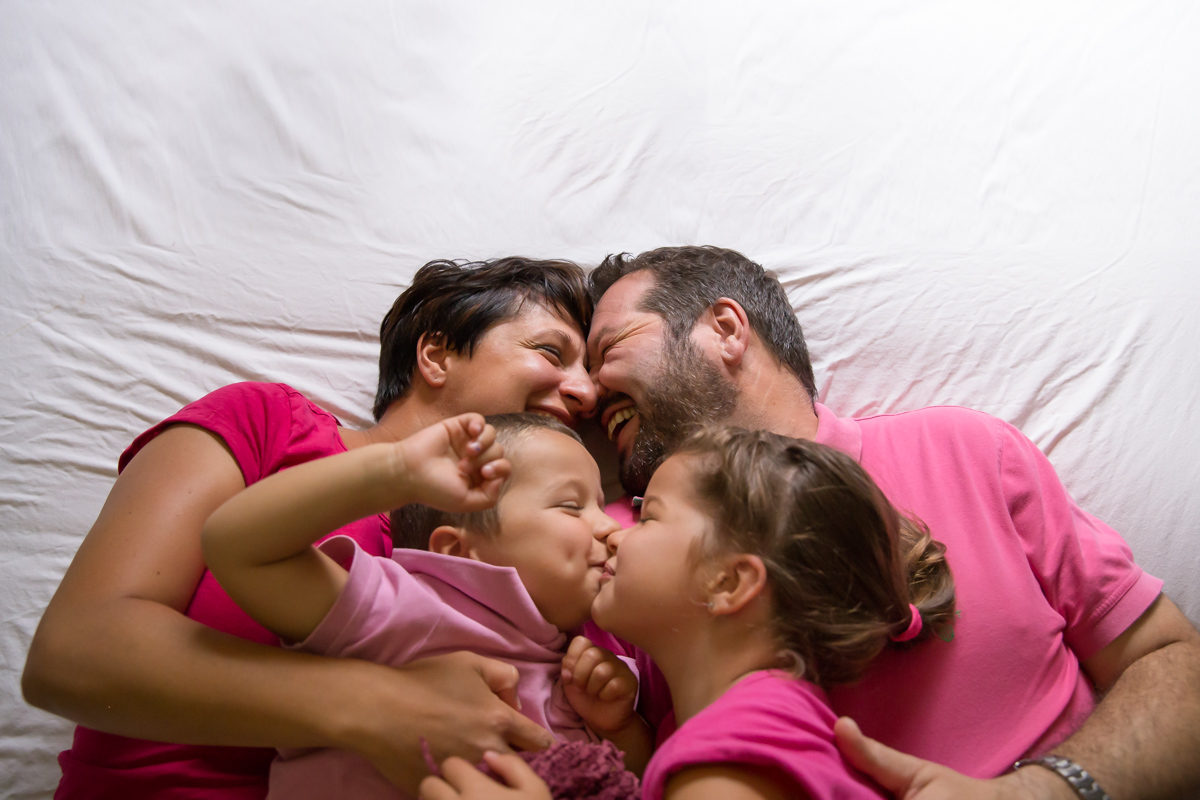 family together laughing and facing one another | Calgary family photographer