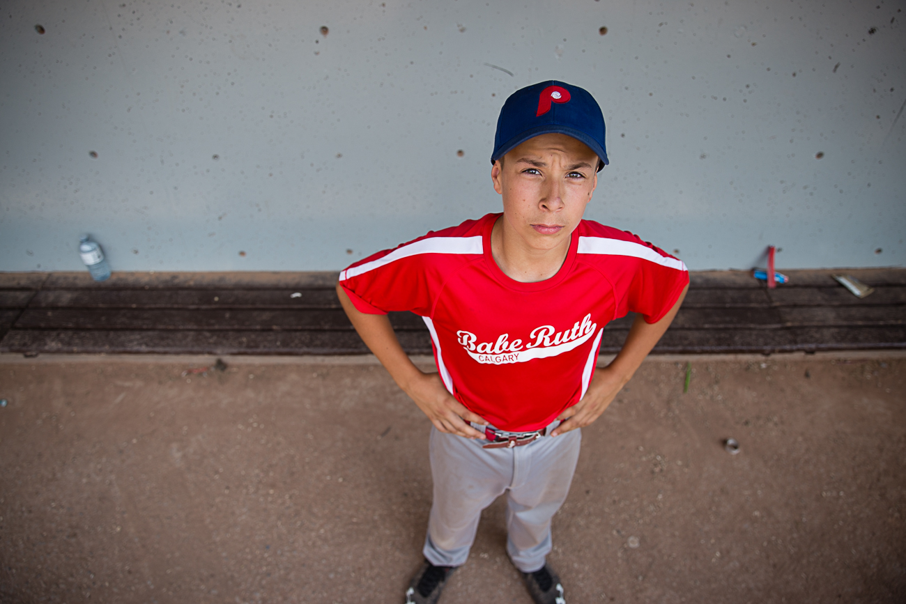 portrait of a baseball player in the dugout   Calgary child photographer