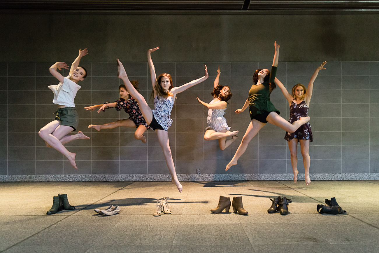 dancers jumping with their shoes in front of them