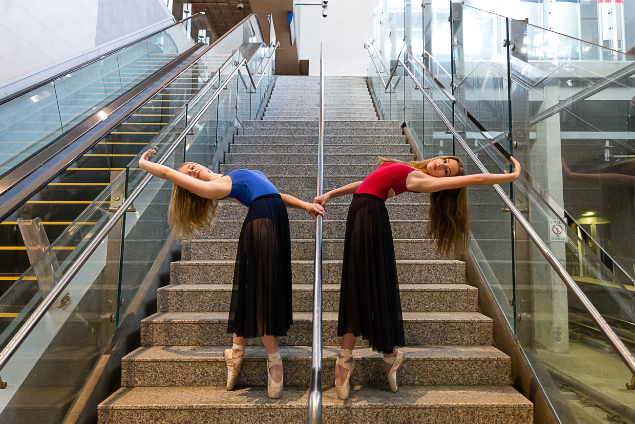 two girls bending backwards on the stairs