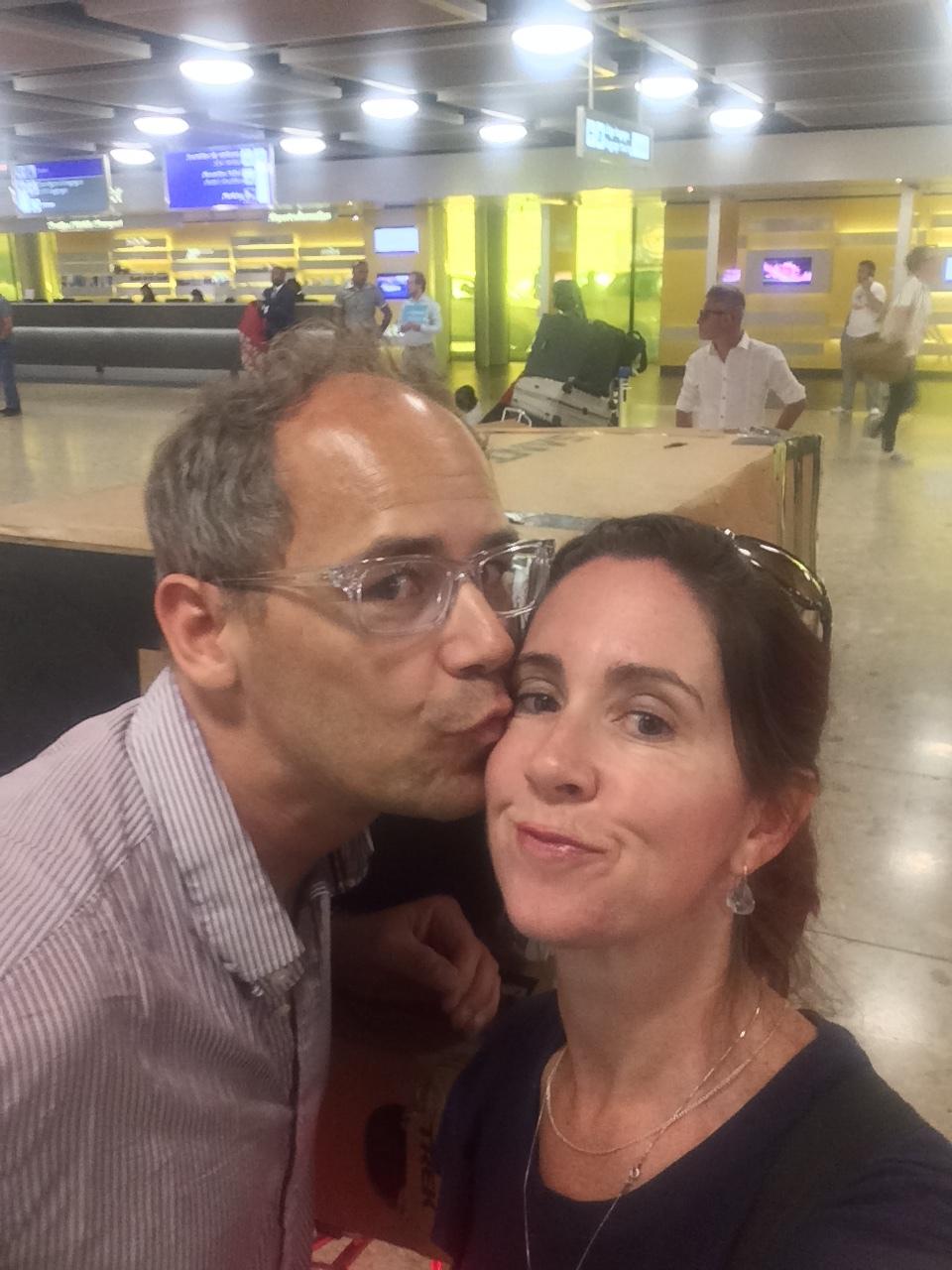 man kissing wife on cheek