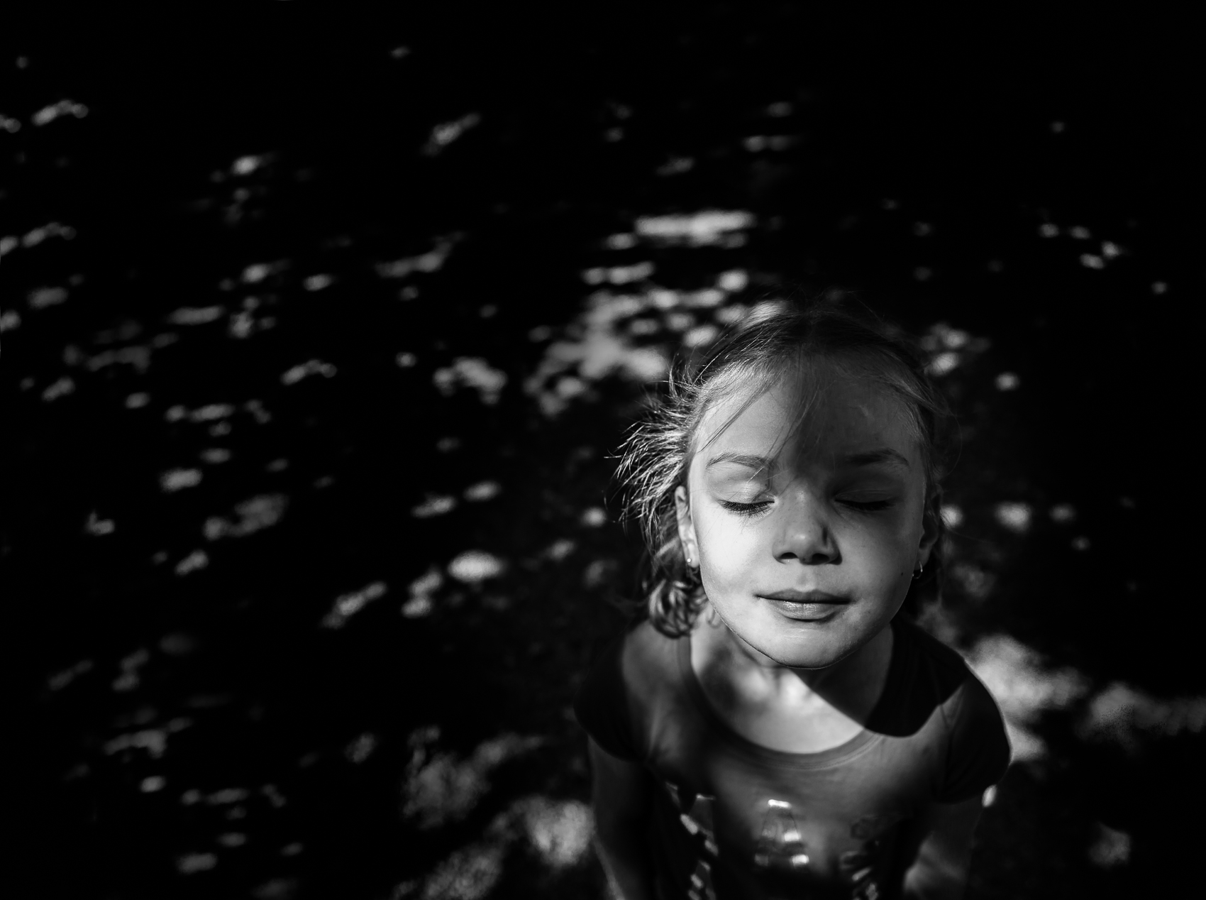 face to the sun, streaming hot and excited, the nerves of the day dissipated in the shade of the playground.