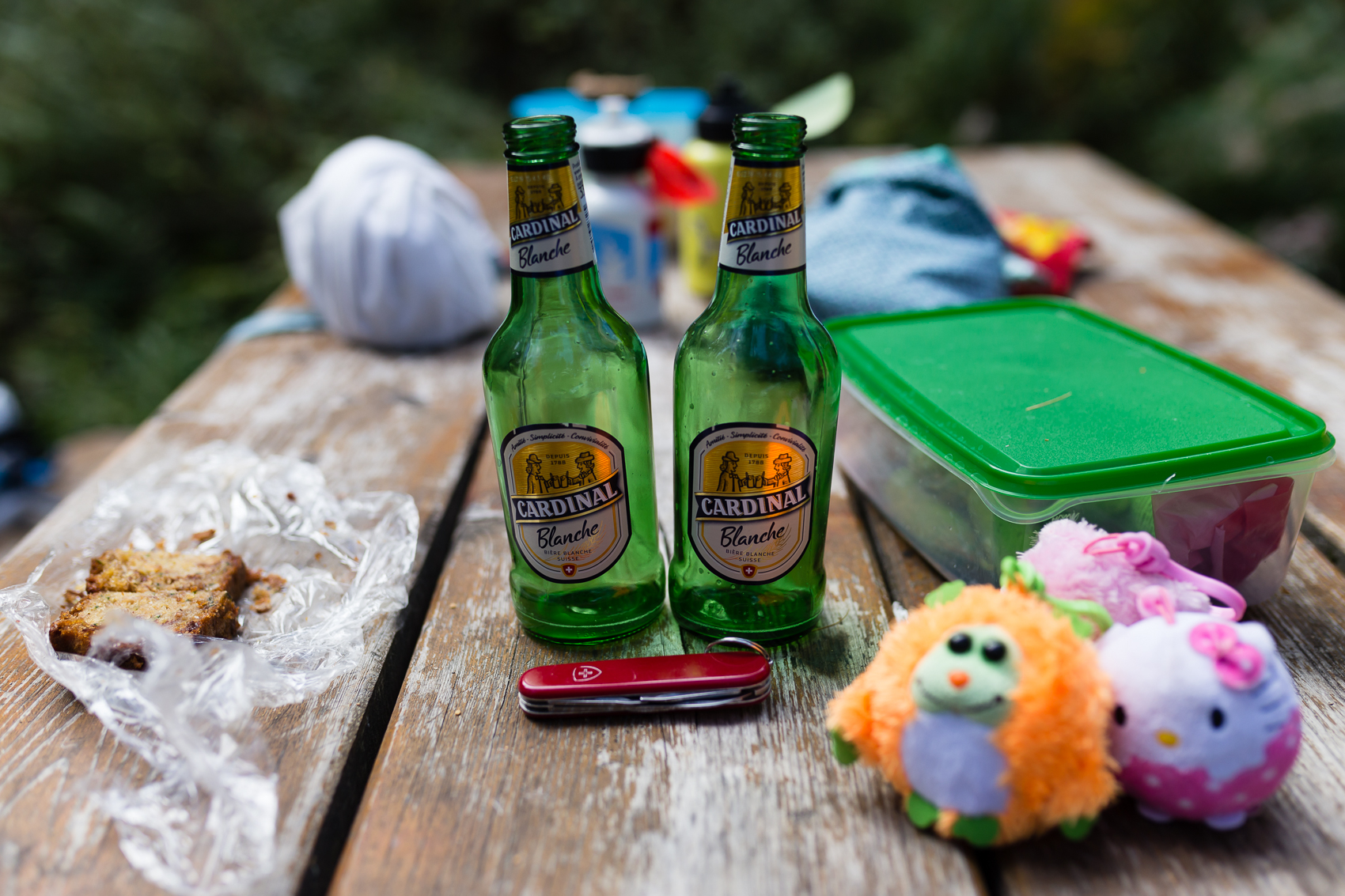 beer bottles on the table, Swiss army knife