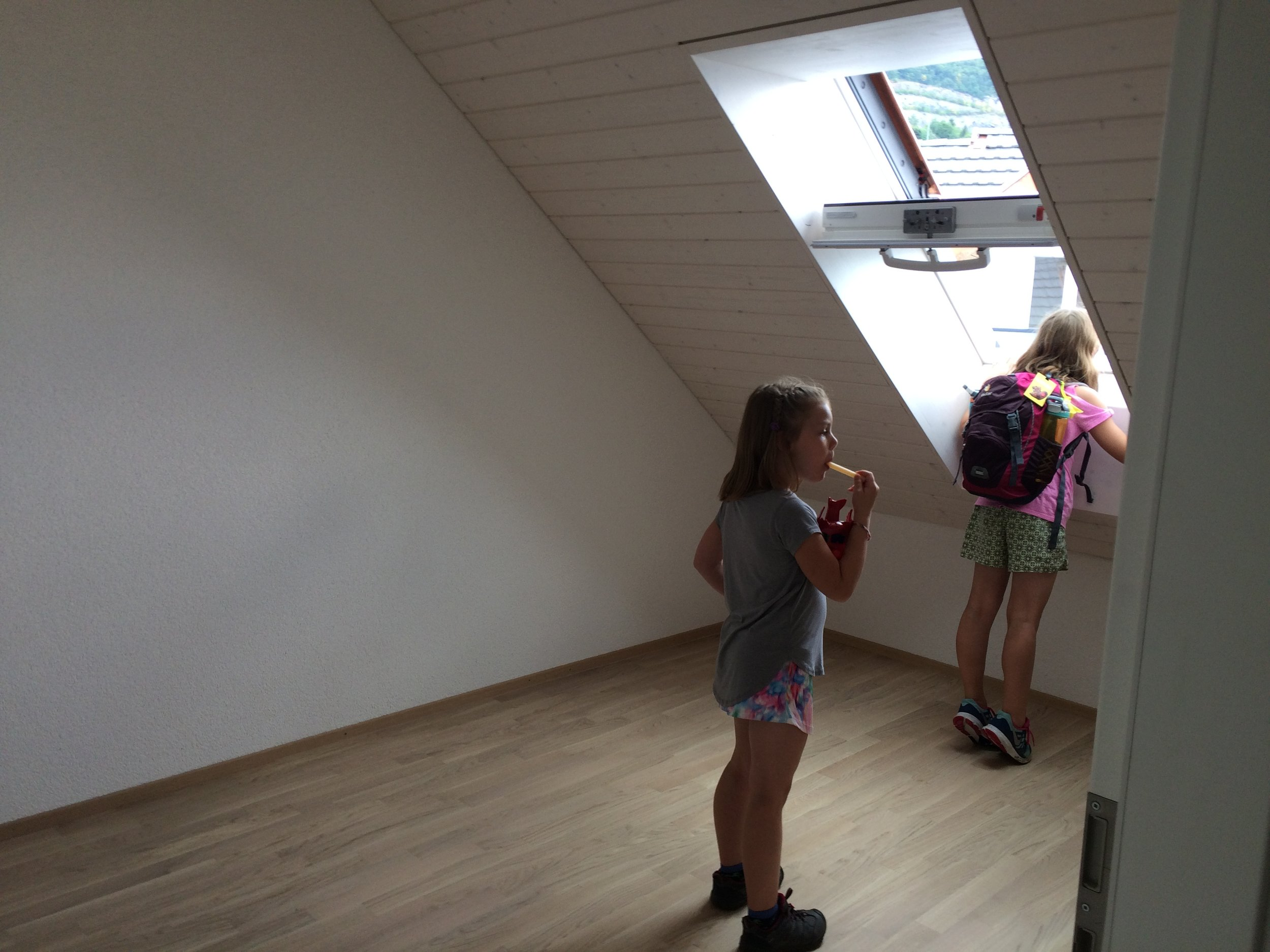 Apartment hunting with backpacks and popsicles. Views out the window imperative to the right choice - this apartment was the winner - Harry Potter style stair hideout thank you very much!