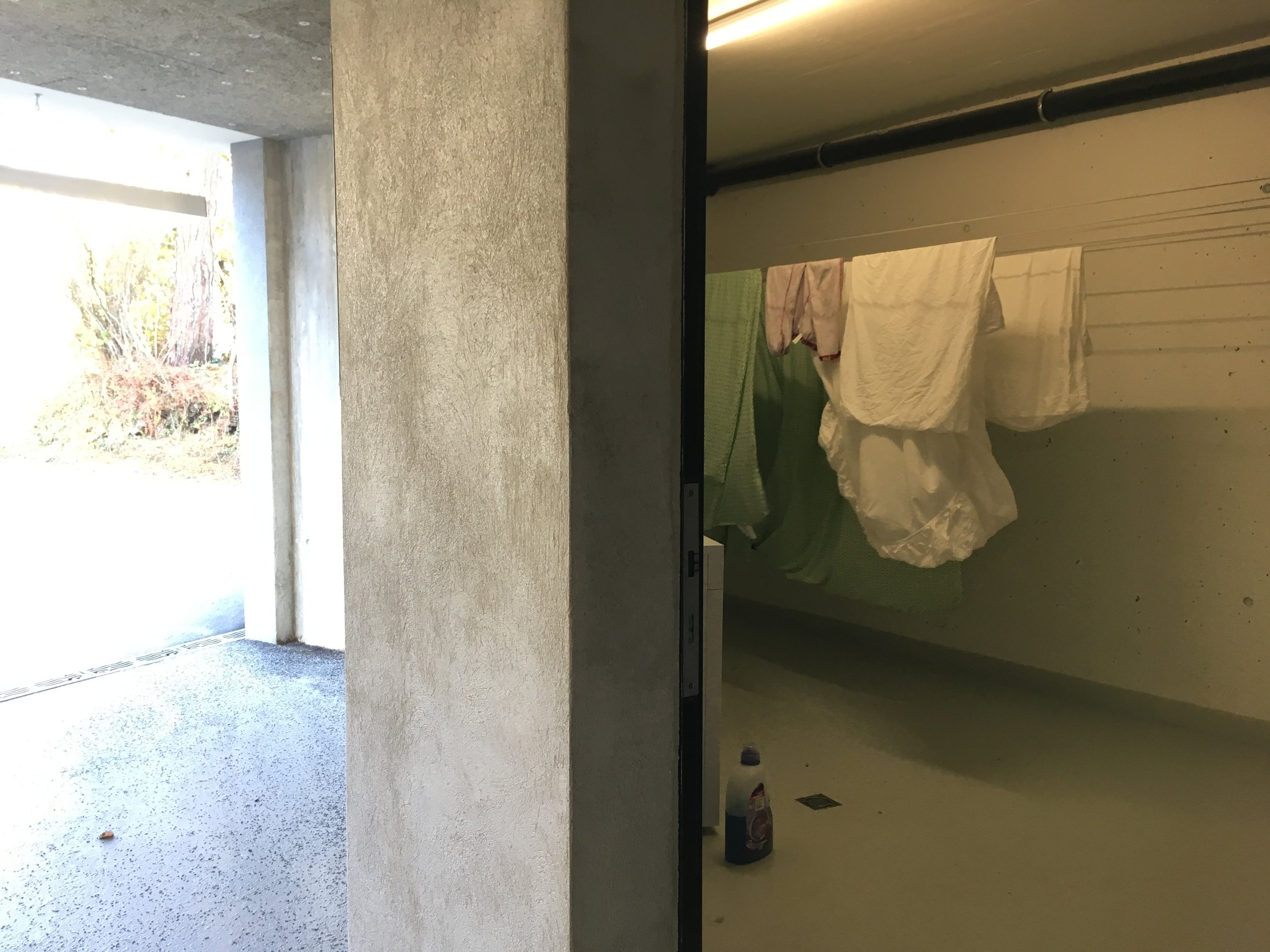 One quick run down 3 flights of stairs and through the parking garage to our little laundry heaven! Despite there being a dryer that functions decidedly differently that what we are used to, we too have 'swissified' ourselves and love hanging everything to dry.