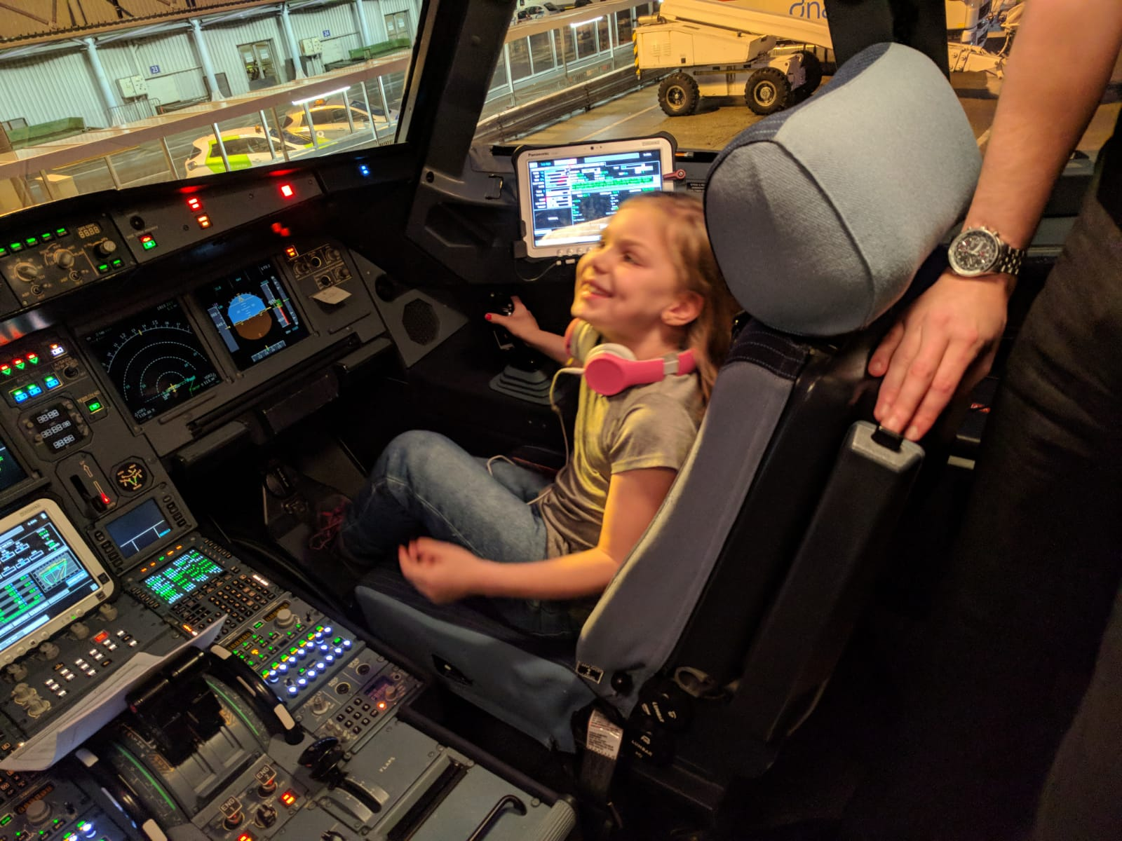 child in the cockpit of a plane