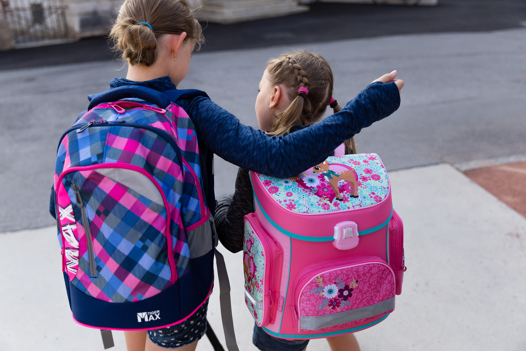 two of them together - backpacks ready and them saying goodbye as they headed off in different directions to their respective schools, while the big people huffed and puffed behind them on the 8 back and forths during the day.