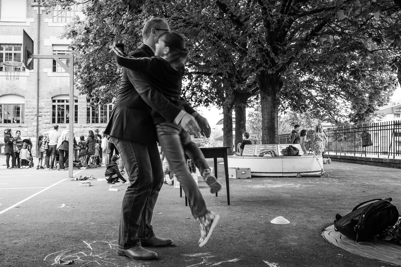Jumping into dad's arms at the end of the day is a joyful ritual.