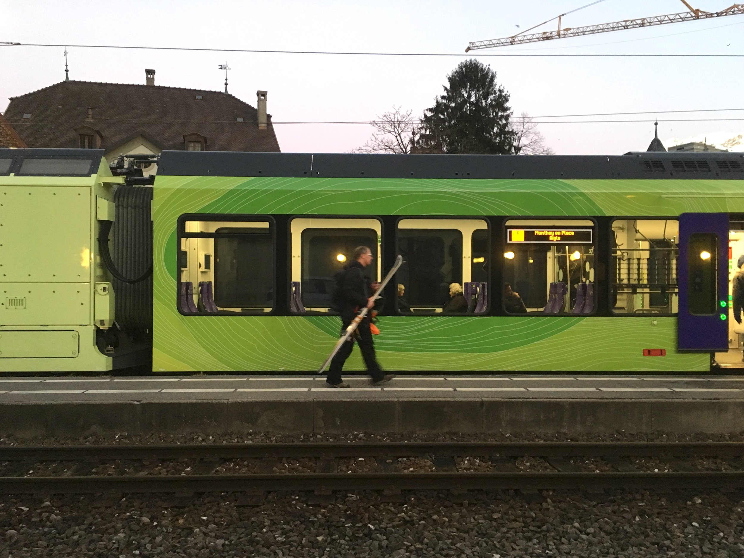 The little green train that takes us up to a slice of heaven - back down after an afternoon ski - happy Tony.