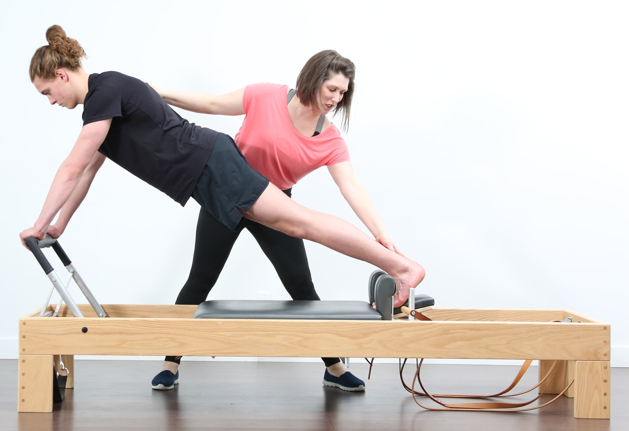 Long Stretch on the Reformer. With Private sessions and small class sizes we are always close to help you 'find' the movement!