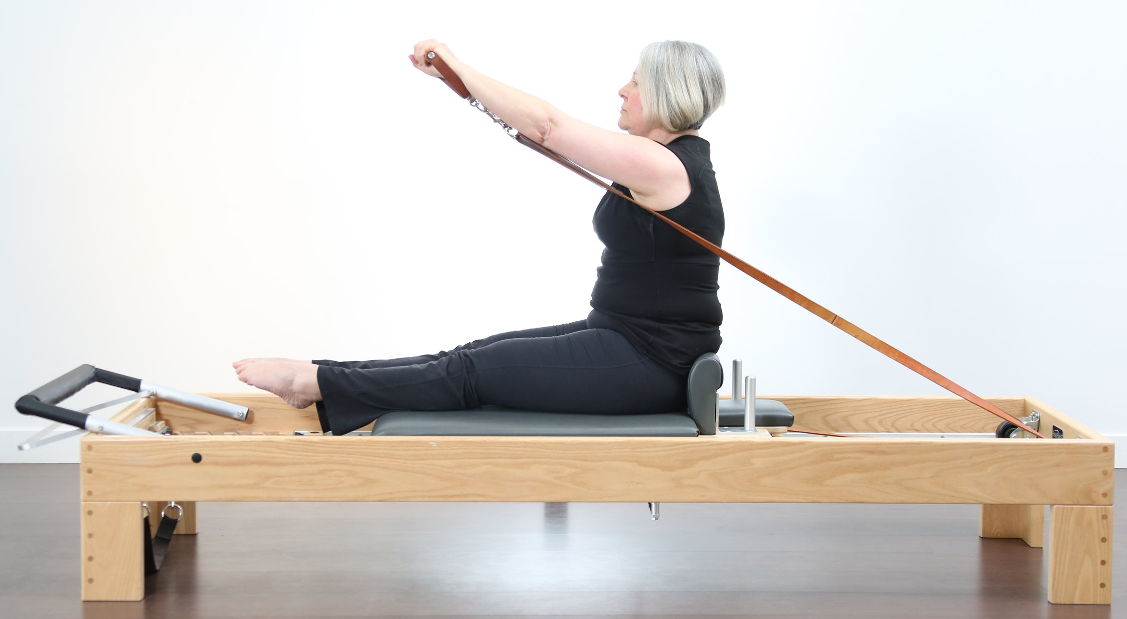 The Reformer is so versatile. You can sit, lie down, put your hands or feet in the straps and even stand on the carriage!